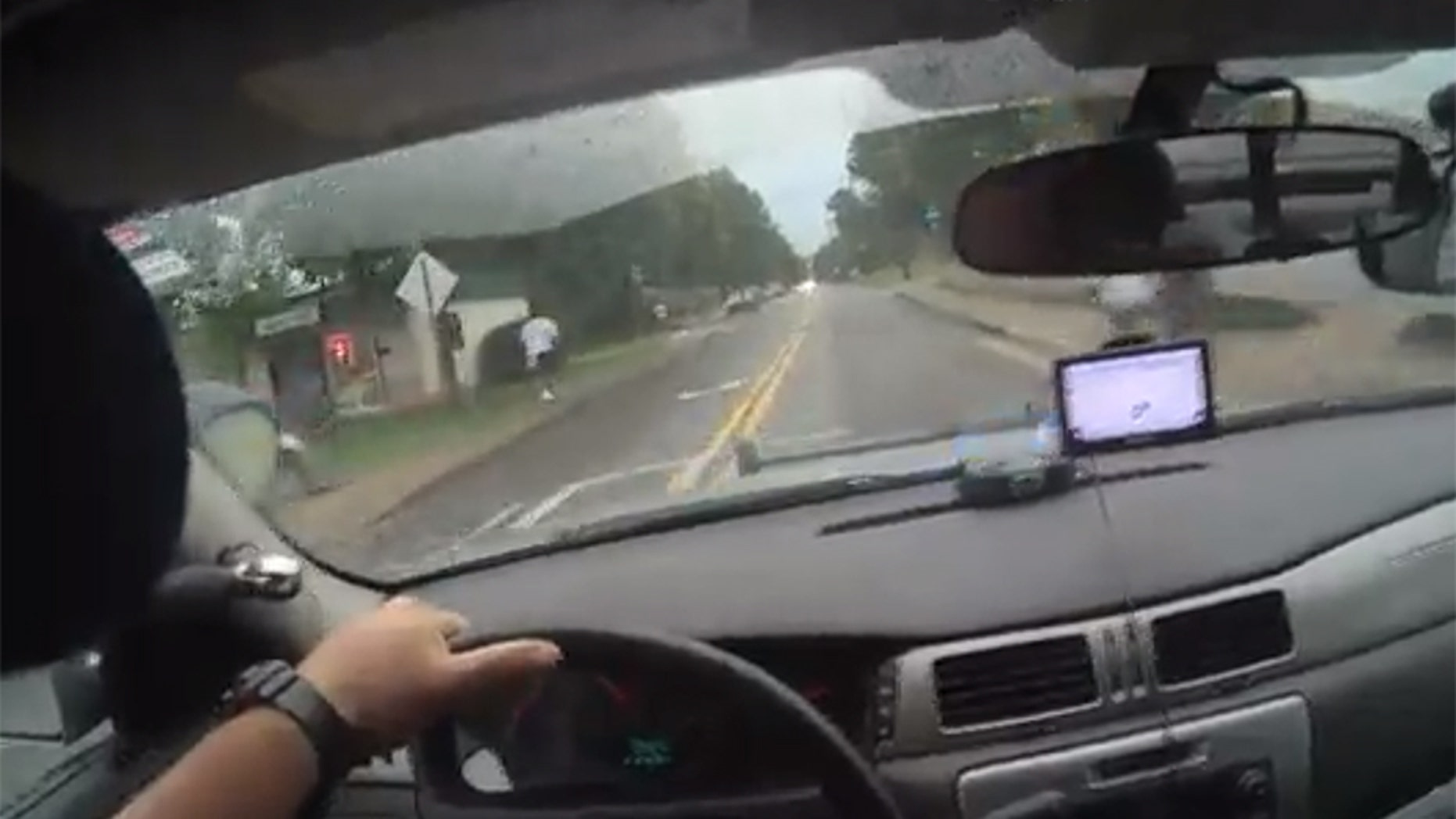 Image from bodycam video showing Athens-Clarke County Police Officer Taylor Saulters in pursuit of a suspect Friday in east Athens.