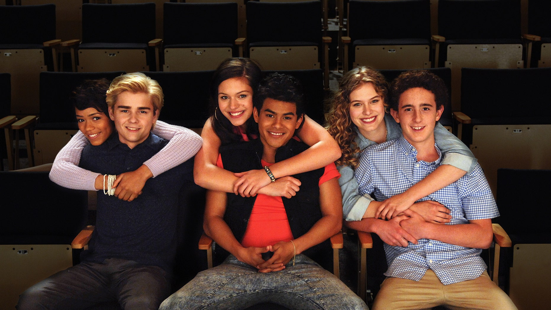 "A photo of the cast from ""The Unauthorized Saved By The Bell Story."""