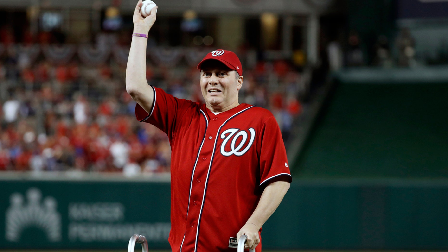 Scalise throwing out the first pitch at Nationals Park before a game last year.