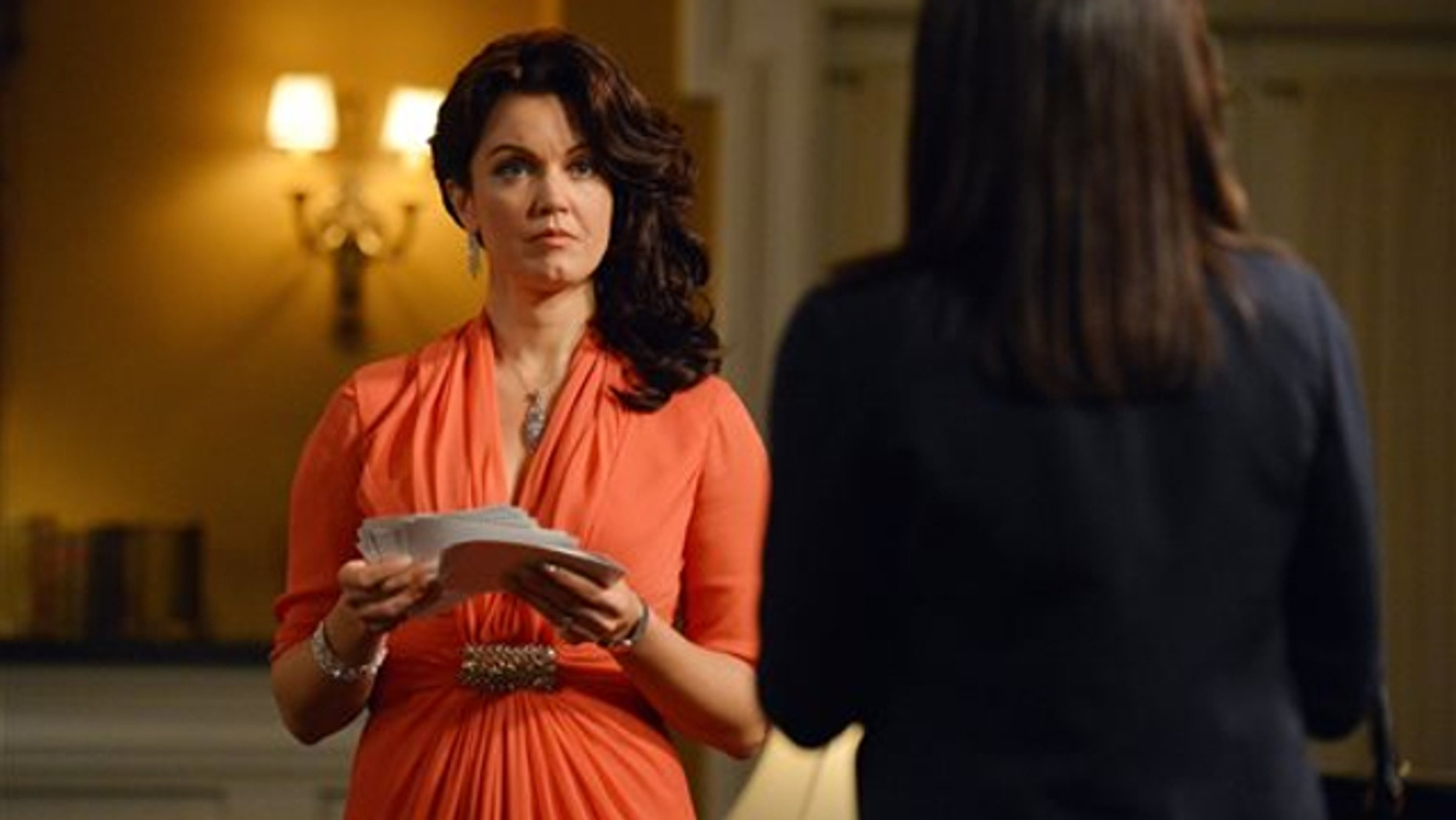 "This photo released by ABC shows, Bellamy Young, left, as Mellie Grant, and Kerry Washington, as Olivia Pope, in an episode ""We Do Not Touch the First Ladies,"" of the TV series, ""Scandal,"" Thursday, March 6, 2014, 10:00-11:00 p.m., ET on the ABC Television Network."
