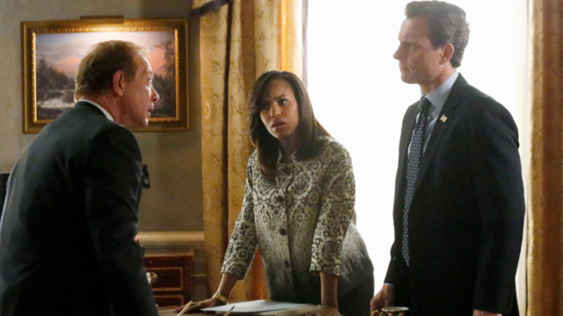 """This image released by ABC shows actors, from left, Jeff Perry, Kerry Washington and Tony Goldwyn in a scene from """"Scandal."""" The series airs Thursdays at 10 p.m. EST on ABC."""