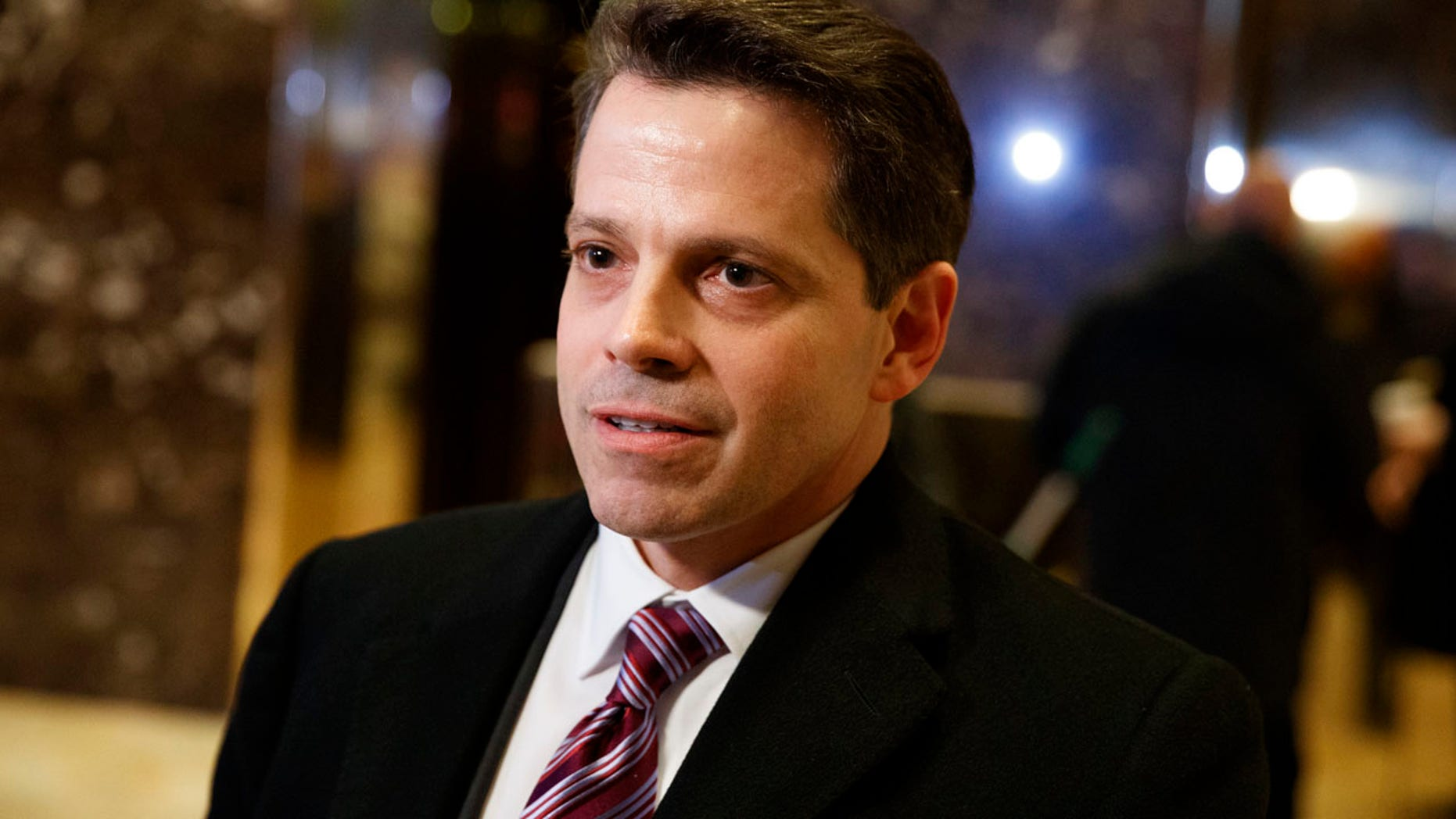 In this Jan. 13, 2017 file photo, Anthony Scaramucci, a senior adviser to President-elect Donald Trump, talks to reporters in the lobby of Trump Tower in New York.