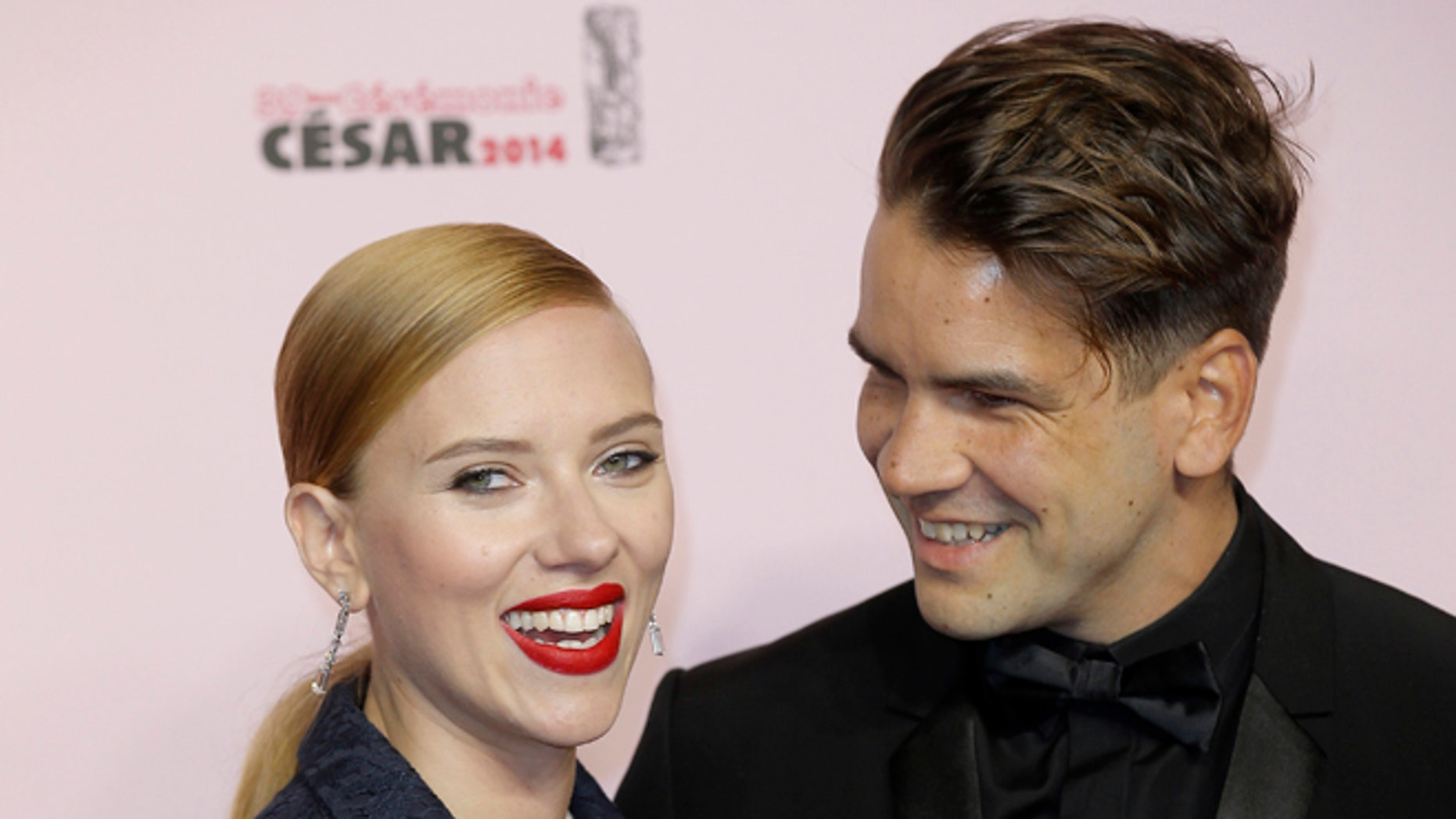 Feb. 28, 2014: Actress Scarlett Johansson, left, and her partner Romain Dauriac arrive at the 39th French Cesar Awards Ceremony, in Paris.