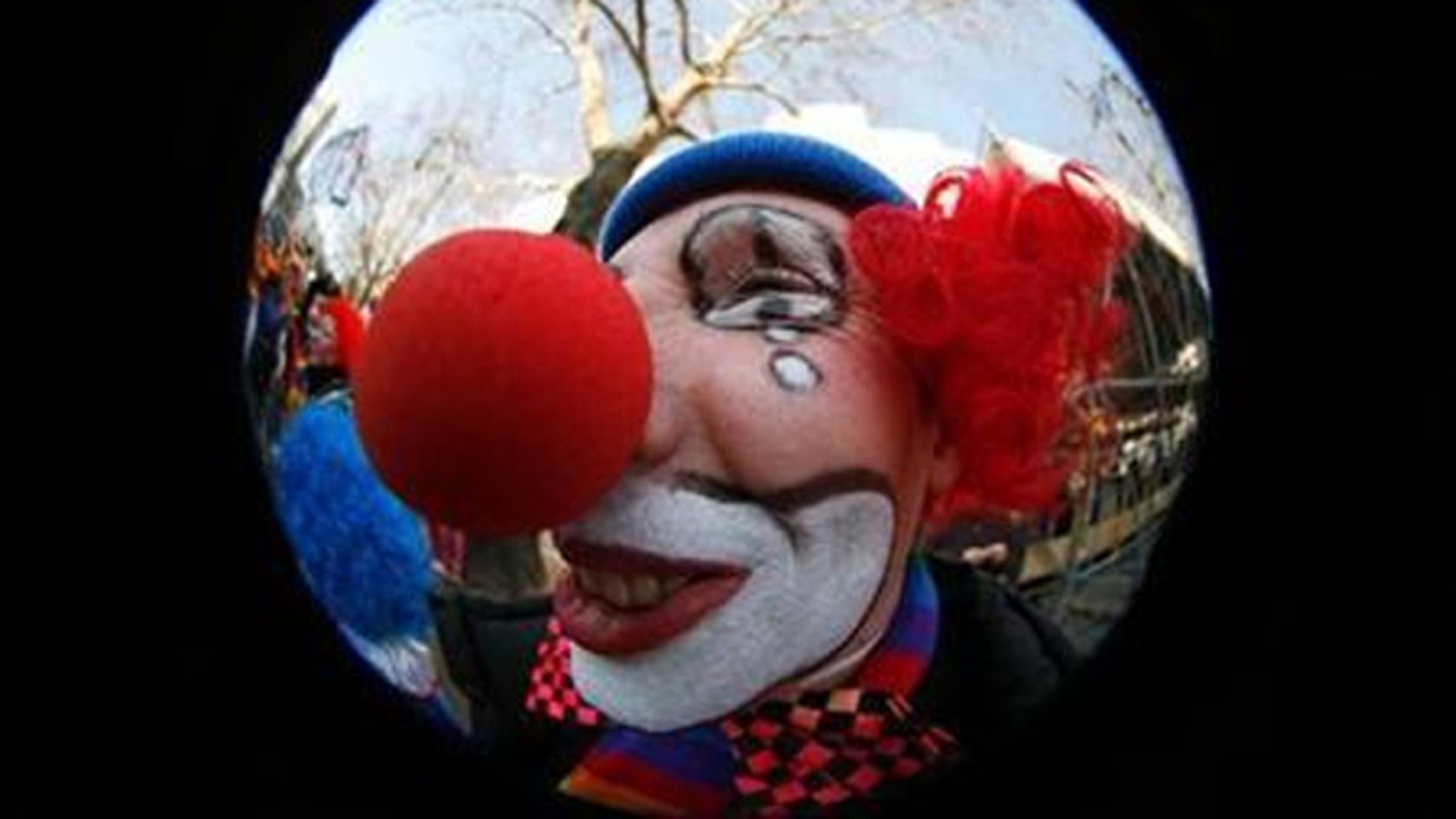 """FILE: A spooky clown looking exactly like Pennywise clown from the Stephen King-inspired 1990 horror film, """"IT"""" -- has appeared in several locations throughout Northampton, England since Friday, Sept. 13."""