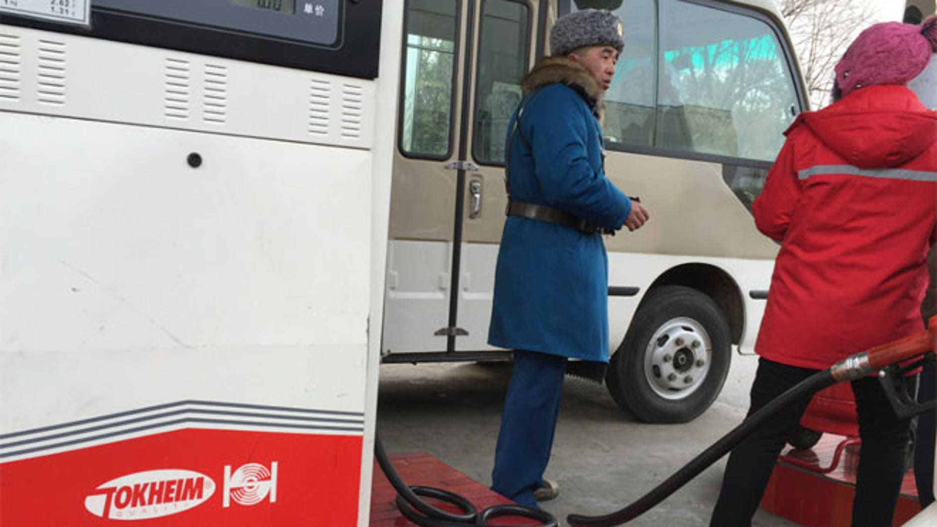 FILE 2016: A customer talks to a gas station attendant in Pyongyang, North Korea.