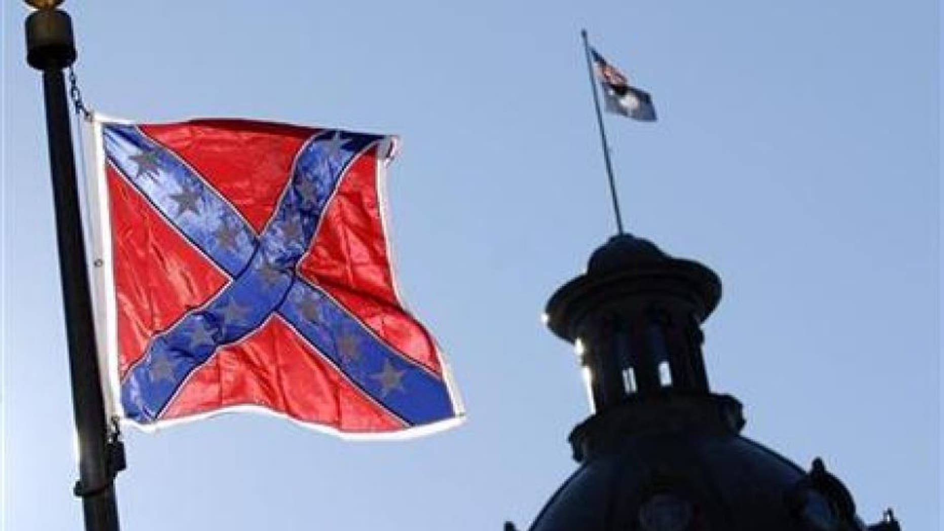 FILE: A Confederate flag flies atop the north end of the South Carolina Statehouse in Columbia