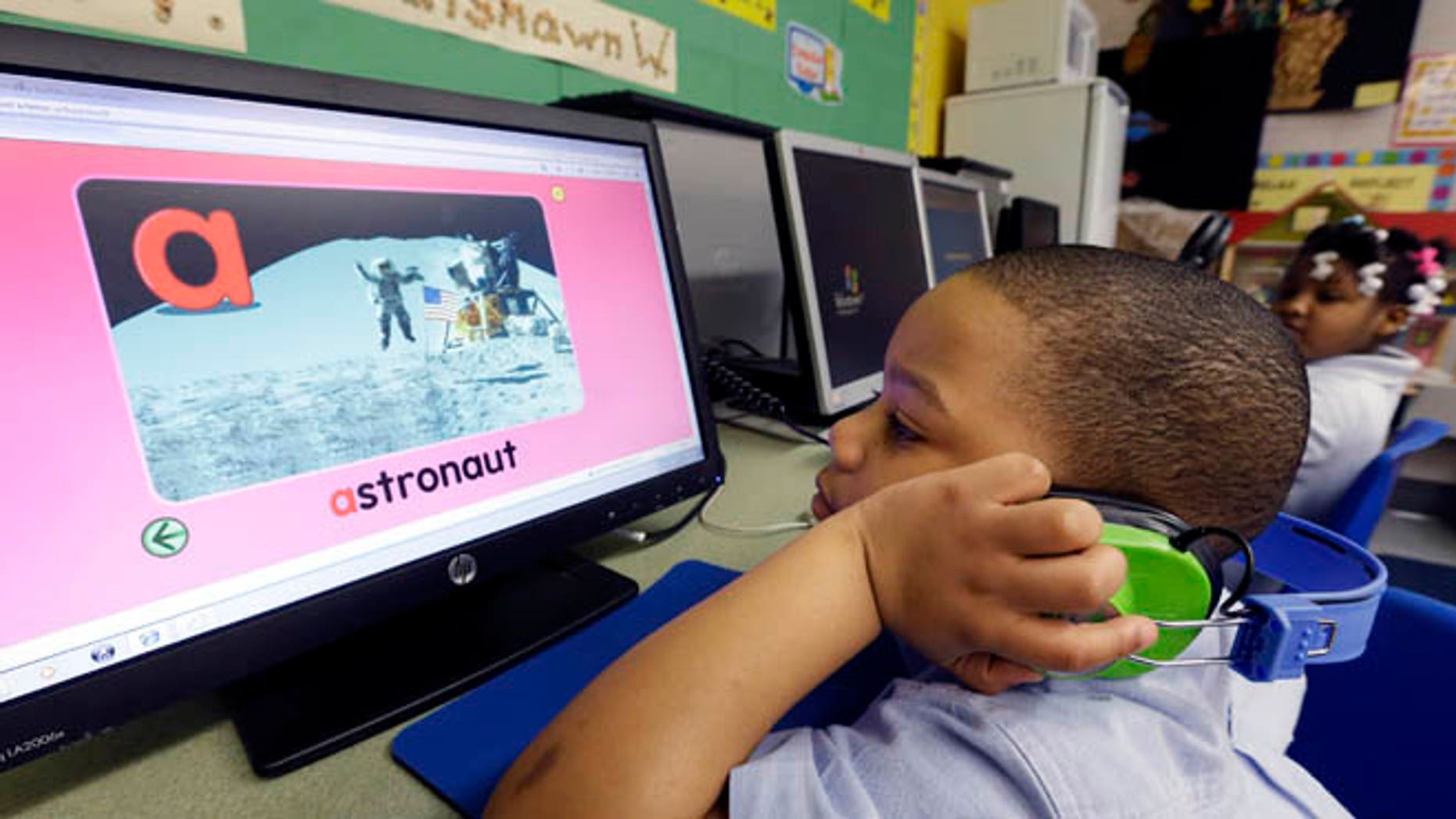 Friday, March 1, 2013: In this photo, Jason Hayes works on a computer in his prekindergarten class at a public school in Buffalo, N.Y. President Barack Obama's proposal to expand access to preschool is seen as a way to close the achievement gap for poor and minority students, improve high school graduation rates and ultimately strengthen the workforce.