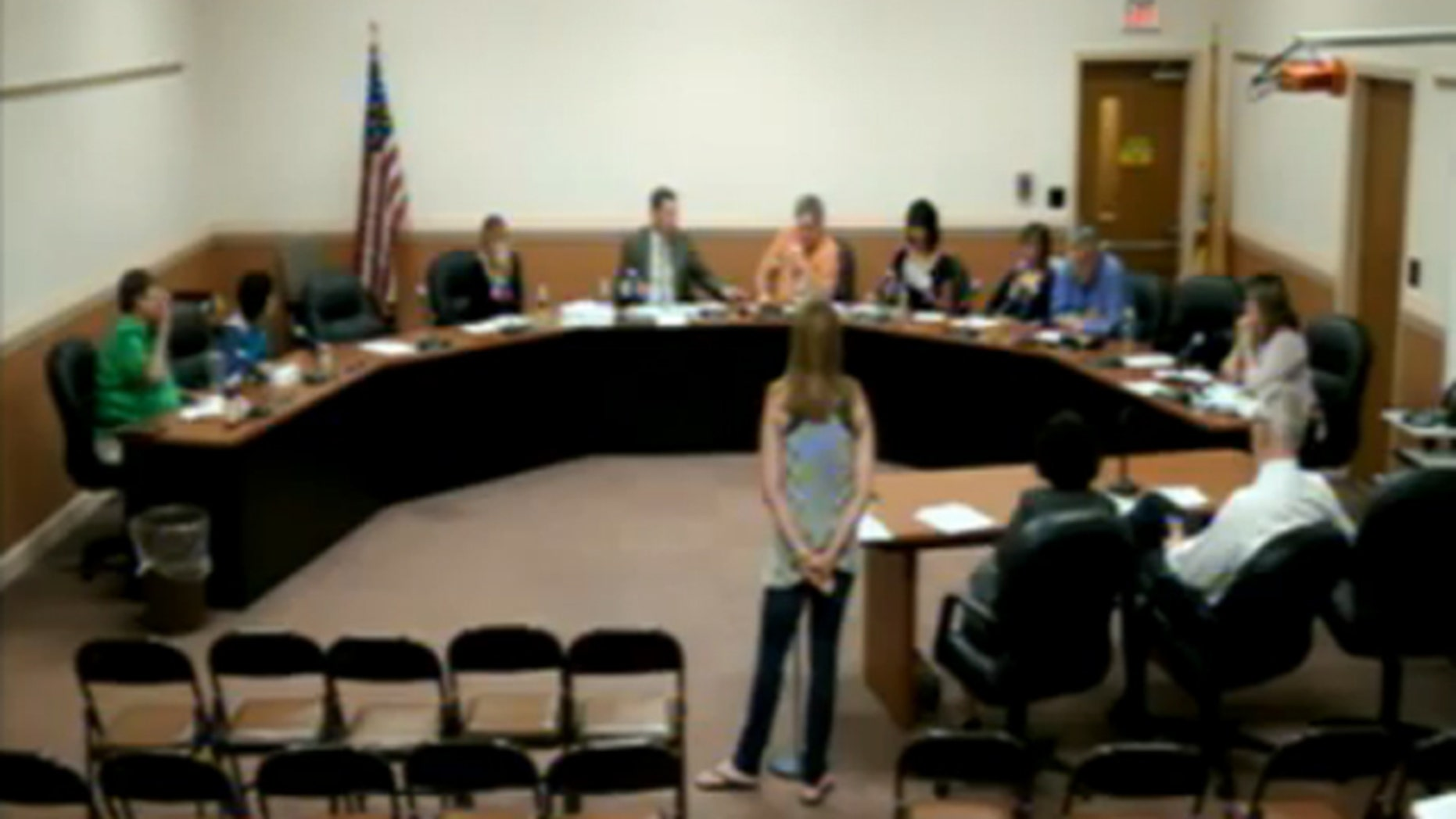 """Valerie Kaufman, center, told the Marlboro Township Board of Education during a June 12 meeting that she found the pledge to be unconstitutional and suggested administrators """"do away"""" with the practice. (Marlboro Township Public Schools)"""