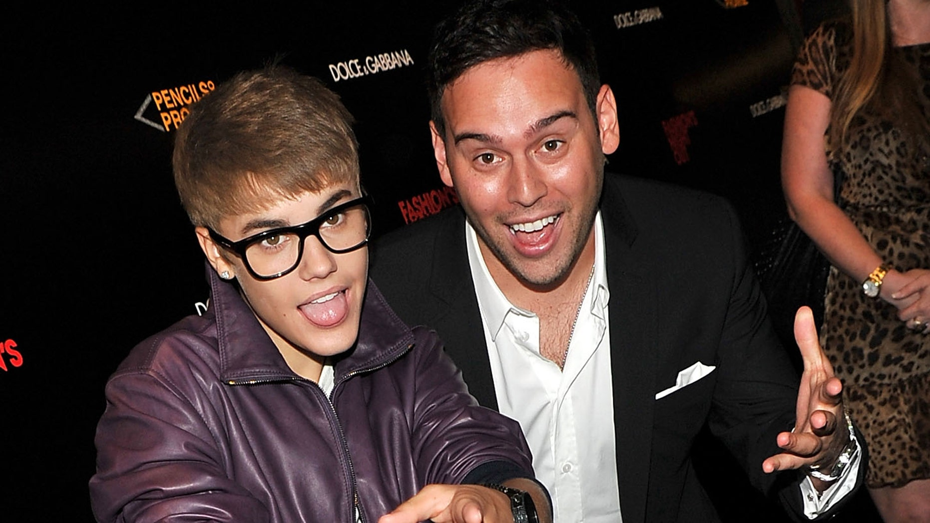 Justin Bieber and Scooter Braun (Photo by Stephen Lovekin/Getty Images for Dolce & Gabbana)