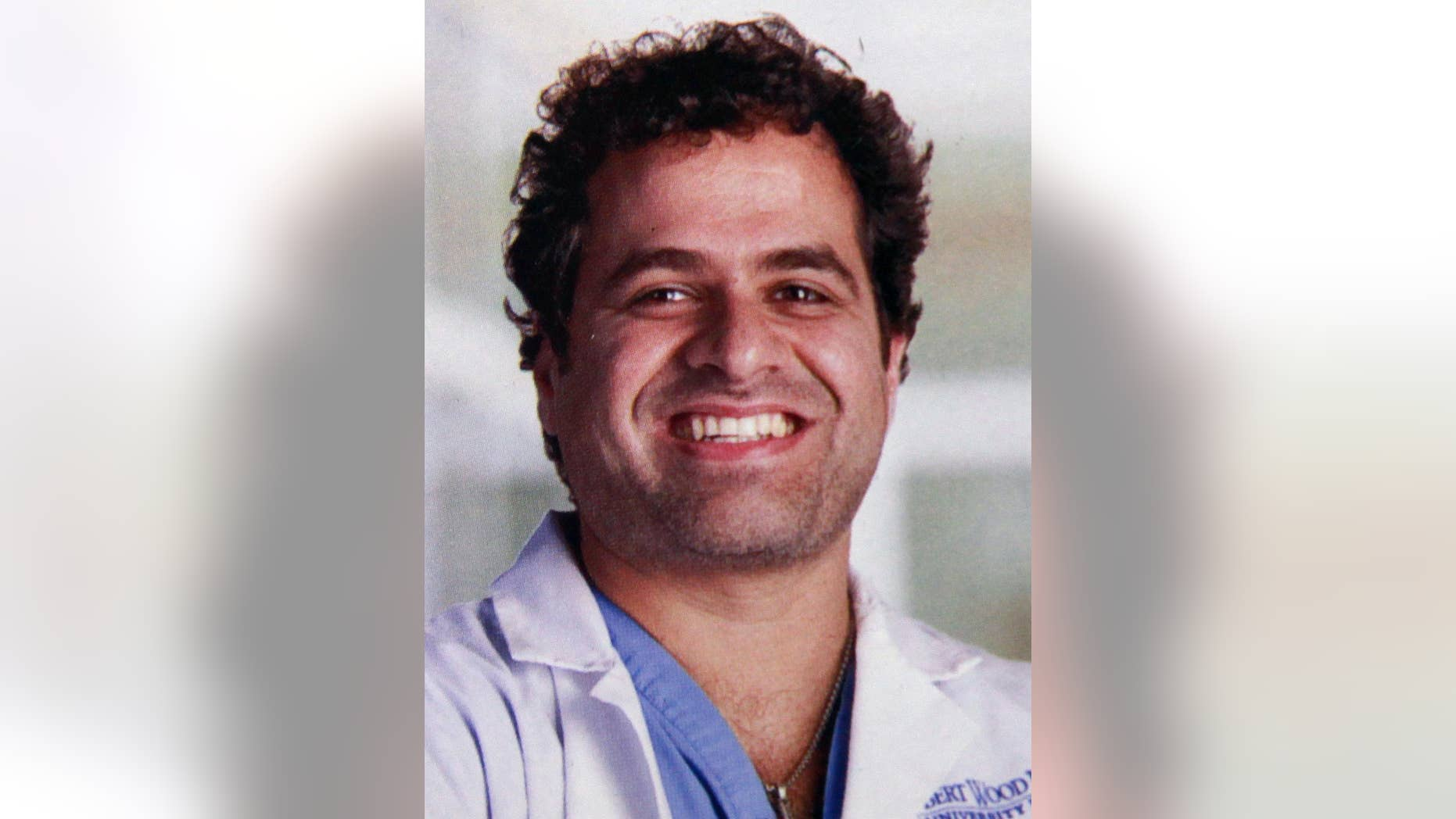 A Manhattan judge has ruled New Jersey cardiologist Dr. Zyad Younan, 44, is off the hook for the $135,000 tab he racked up at Scores strip club. (Robert Wood Johnson University Hospital)