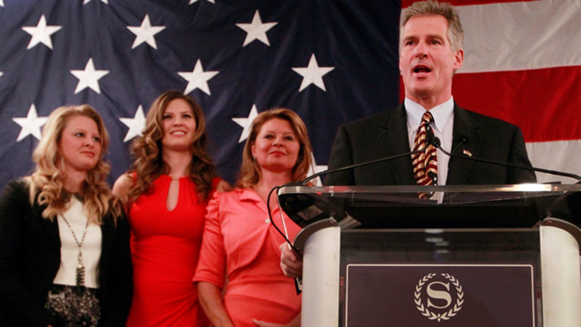 April 10, 2014: With his family at his side, daughters Arianna, left, and Ayla, and his wife Gail, former Mass. U.S. Senator Scott Brown announces his plans to run for the U.S. Senate in New Hampshire.