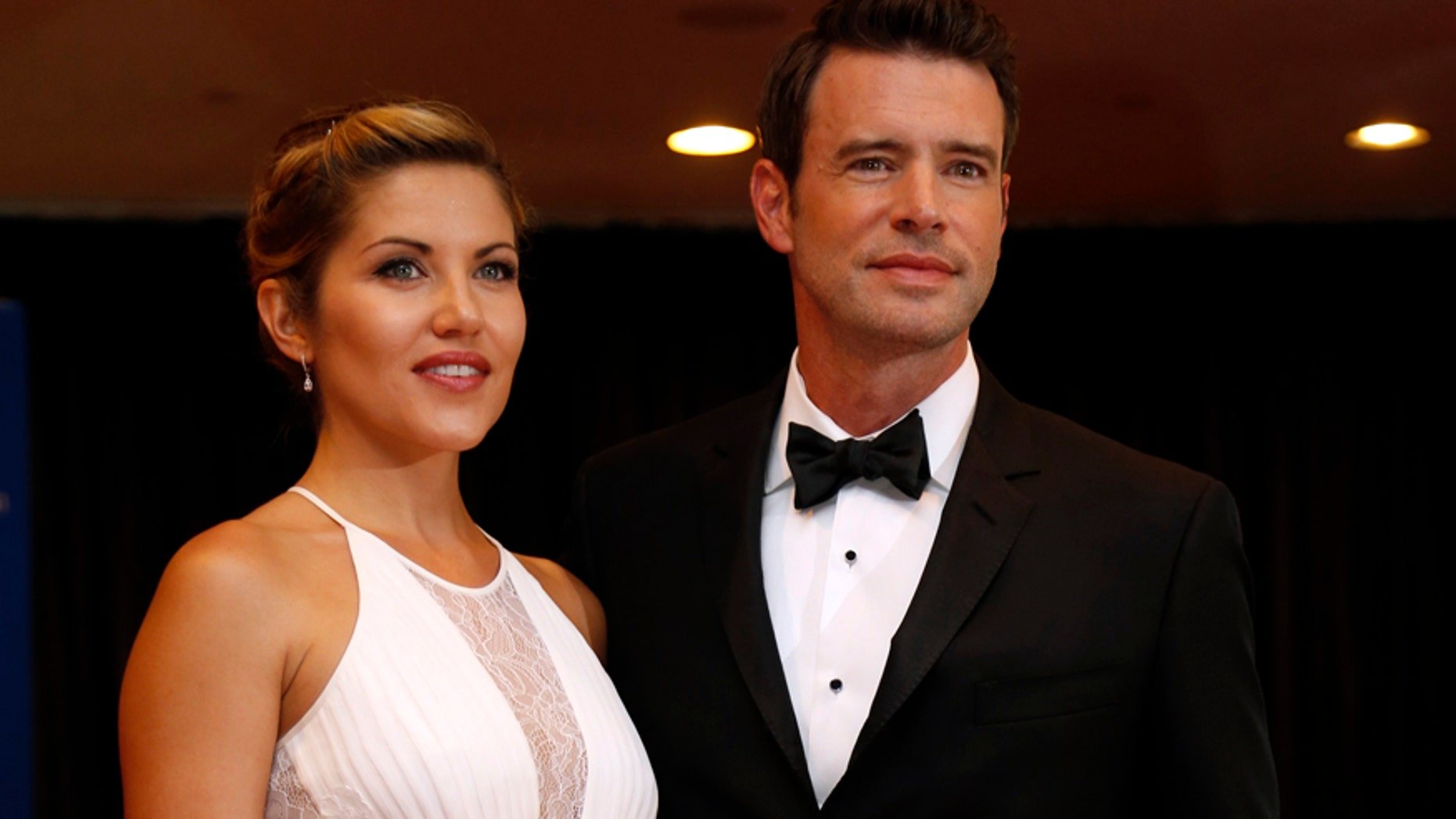 Actor Scott Foley and his wife, Marika Dominczyk, arrive on the red carpet at the annual White House Correspondents' Association Dinner in Washington, May 3, 2014.