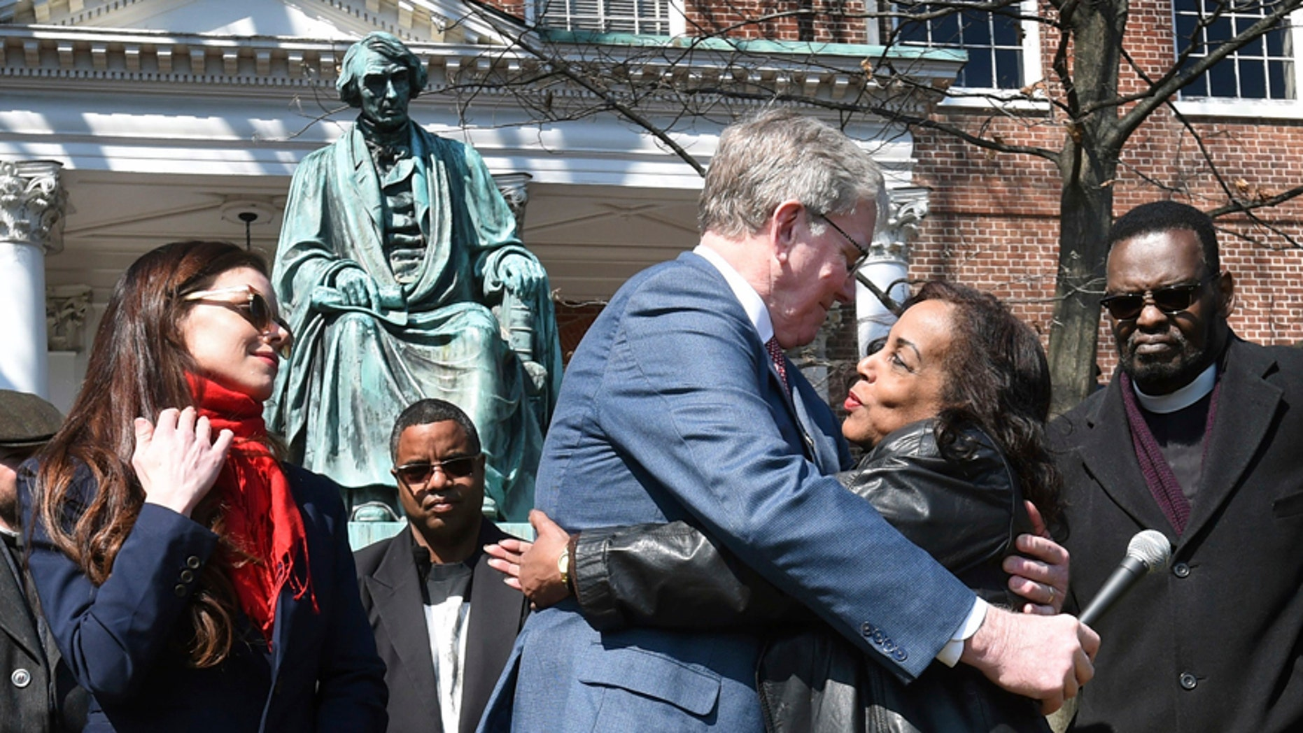 Lynne Jackson, a descendant of Dred Scott, right, hugs Charles Taney III, a descendant of U.S. Supreme Court Chief Justice Roger Taney on the 160th anniversary of the Dred Scott decision in front of the Maryland State House, Monday, March 6, 2017, in Annapolis, Md.
