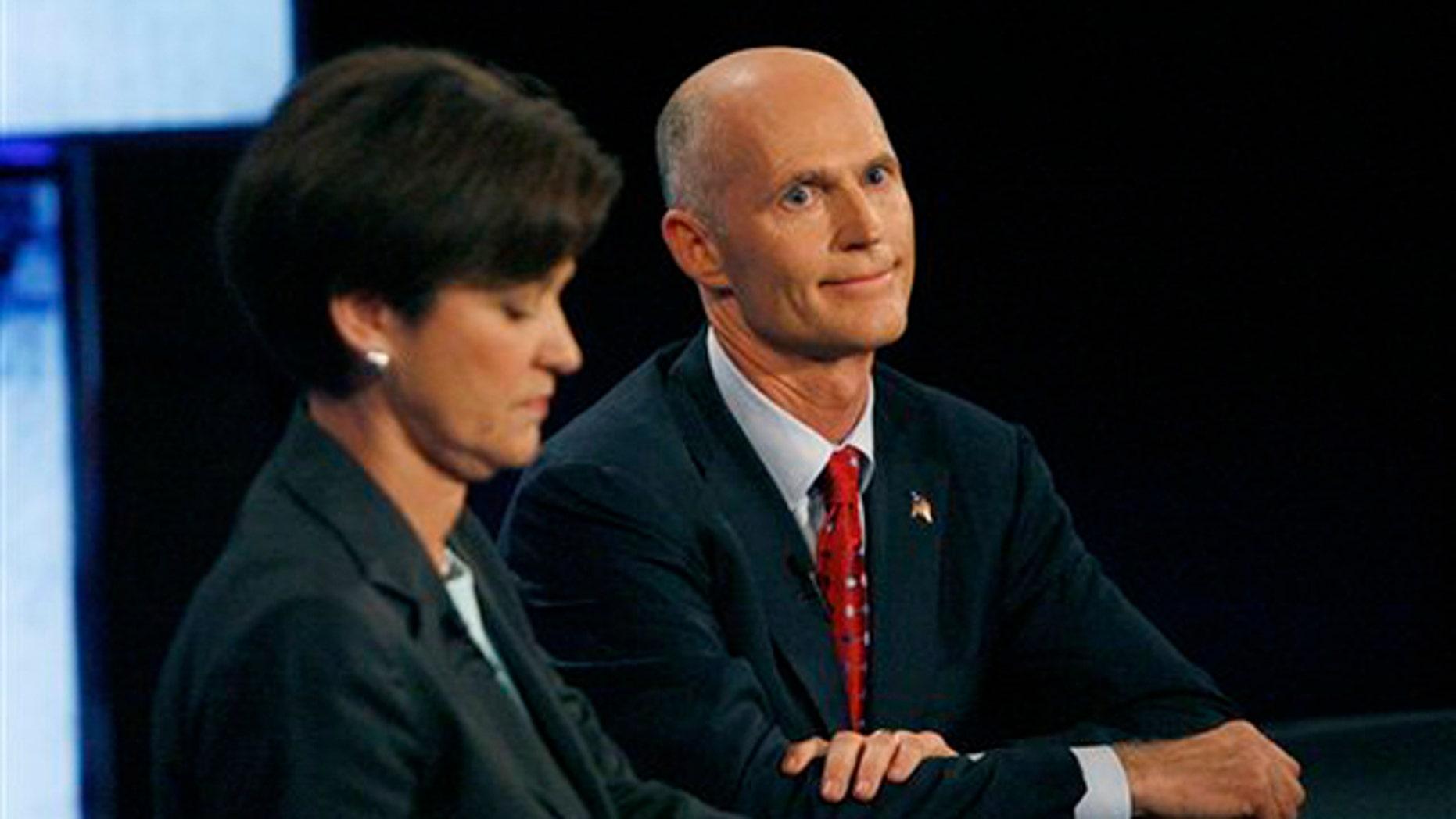 Democratic candidate Alex Sink, left, and Republican candidate Rick Scott participate in a gubernatorial debate Oct. 25 in Tampa, Fla. (AP Photo)