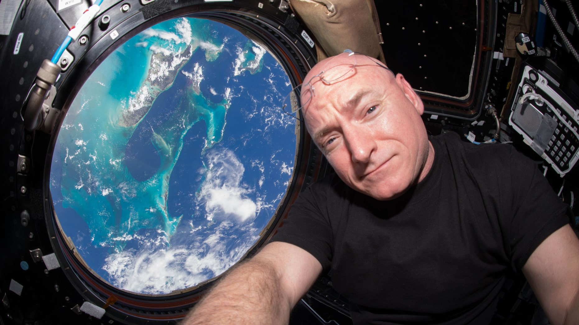 "File photo - In this July 12, 2015 photo made available by NASA, astronaut Scott Kelly poses for a selfie photo in the ""Cupola"" of the International Space Station. (Scott Kelly/NASA via AP)"