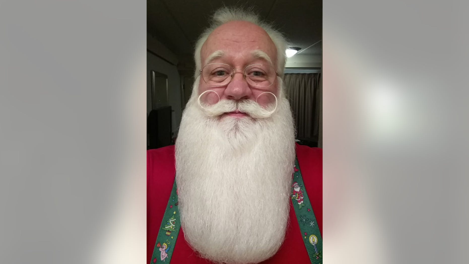 Eric Schmitt-Matzen volunteers as Santa Claus at a local Tennessee hospital.