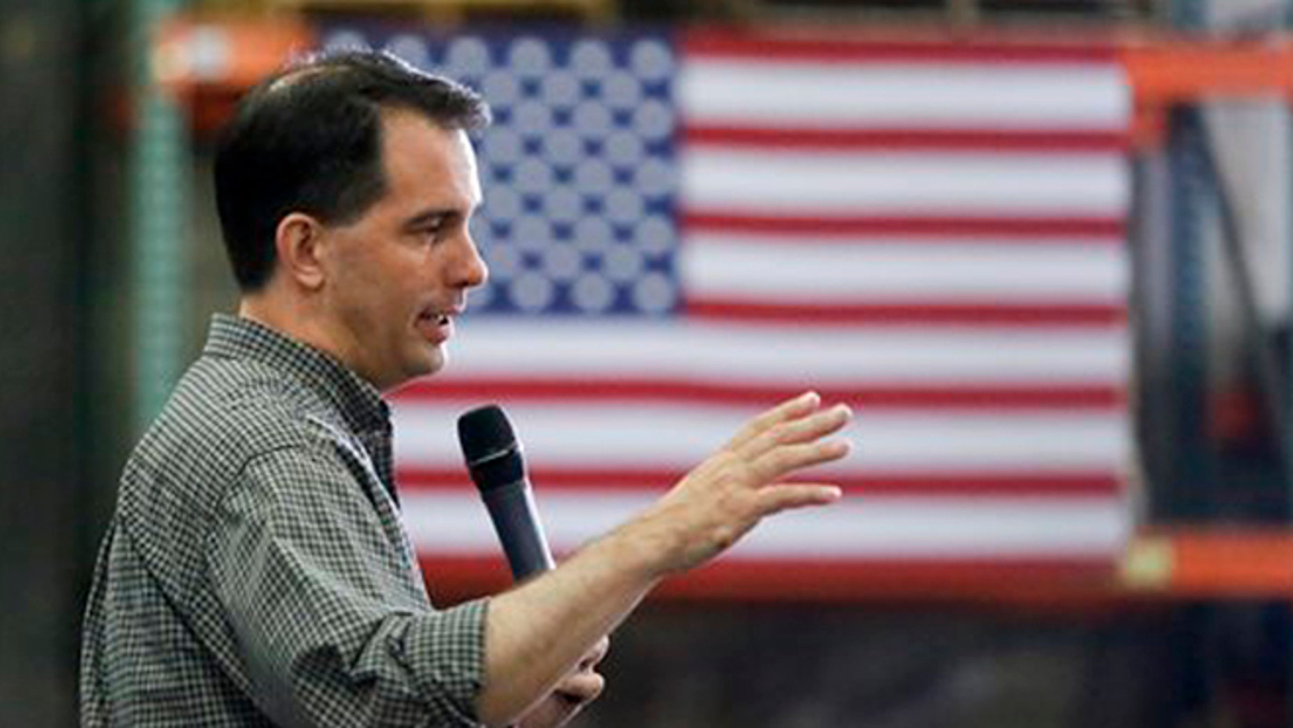 Republican presidential candidate Wisconsin Gov. Scott Walker addresses a crowd at Giese Manufacturing, Sunday, July 19, 2015, in Dubuque, Iowa.