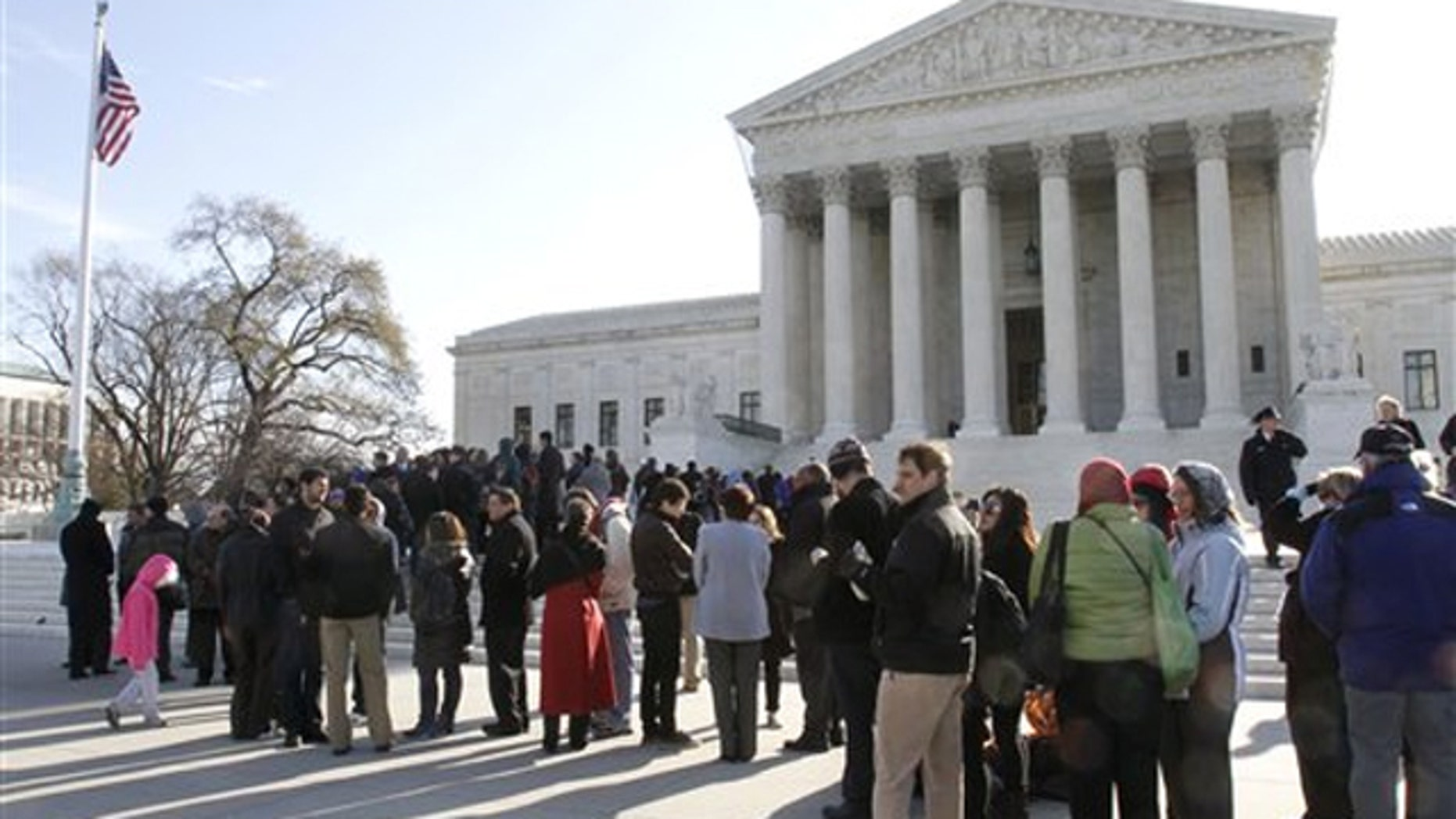 People line up outside the Supreme Court in Washington March 29 to attend a hearing on women employees against Wal-Mart.