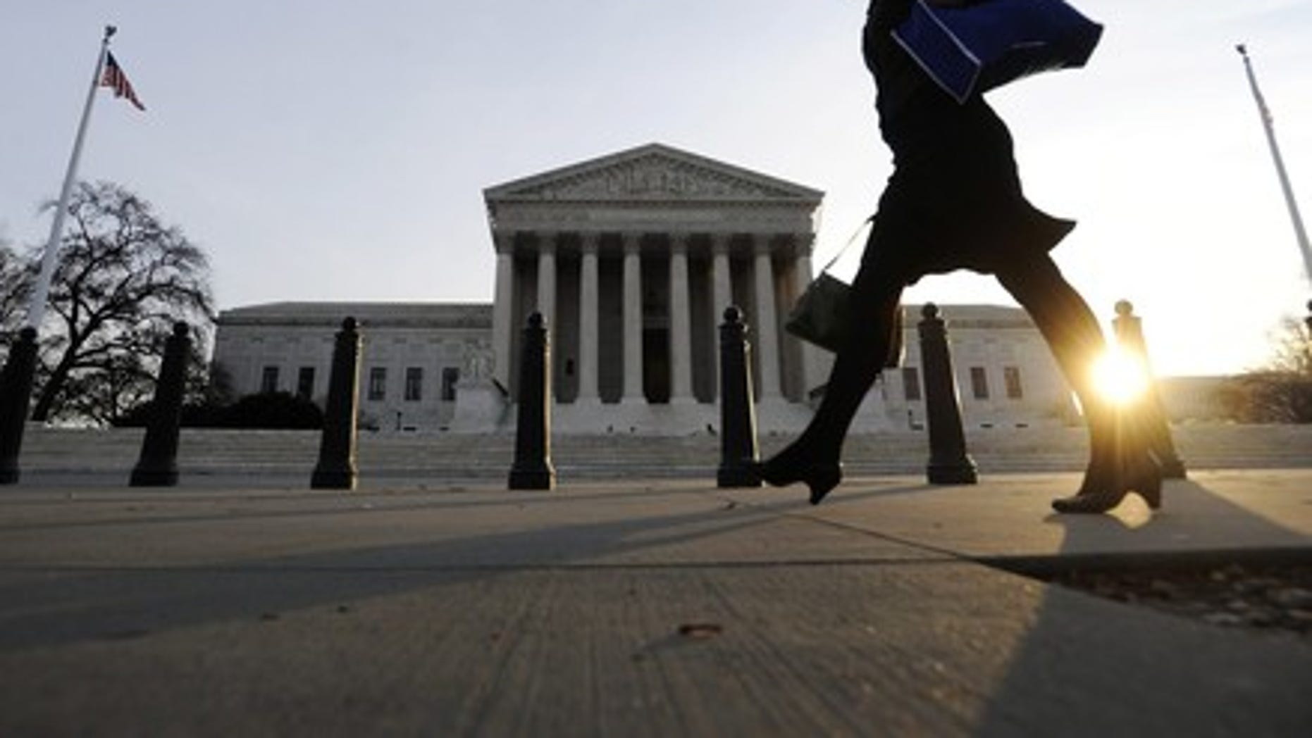 FILE -- A pedestrian walks past the US Supreme Court building in Washington. (REUTERS)