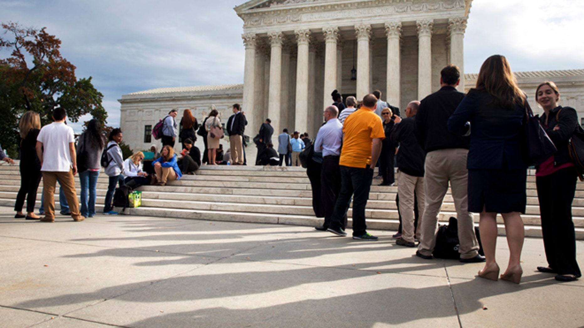 Oct. 13, 2015: People line up outside of the Supreme Court in Washington as the justices began to discuss sentences for young prison 'lifers.'