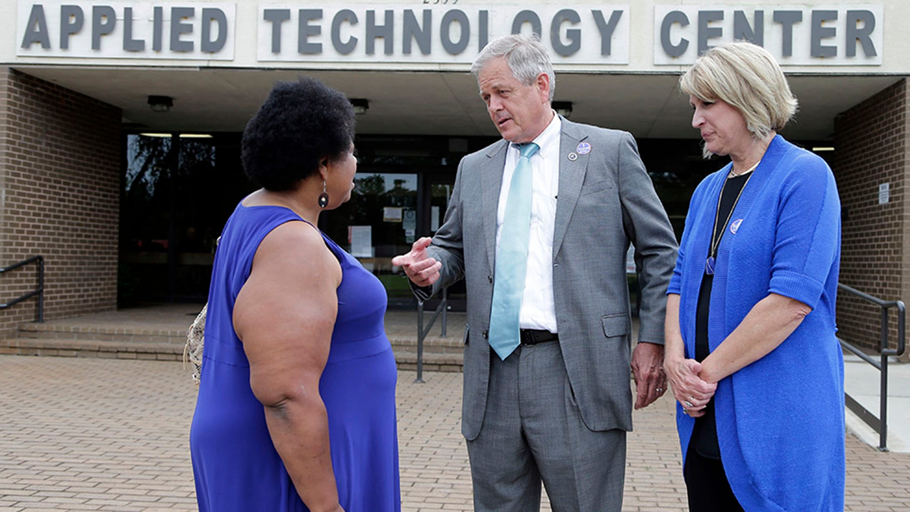Republican candidate for U.S. Congress Ralph Norman, center, speaks with Gladys Jackson, left, as Norman's wife, Elaine, right, looks on at a polling place in South Carolina's 5th Congressional District in Rock Hill, S.C.