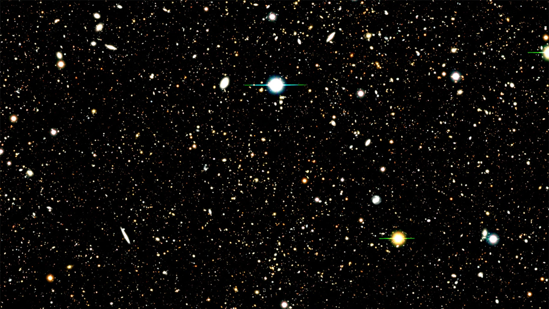 This image shows the results of a deep field survey by the Subaru Telescope. A new analysis used a Subaru deep field image to identify the location of nearly 1,300 distant galaxies. The analysis then combined the UV radiation from those galaxies to learn about their composition. A few bright supernovas can also be seen in the image.