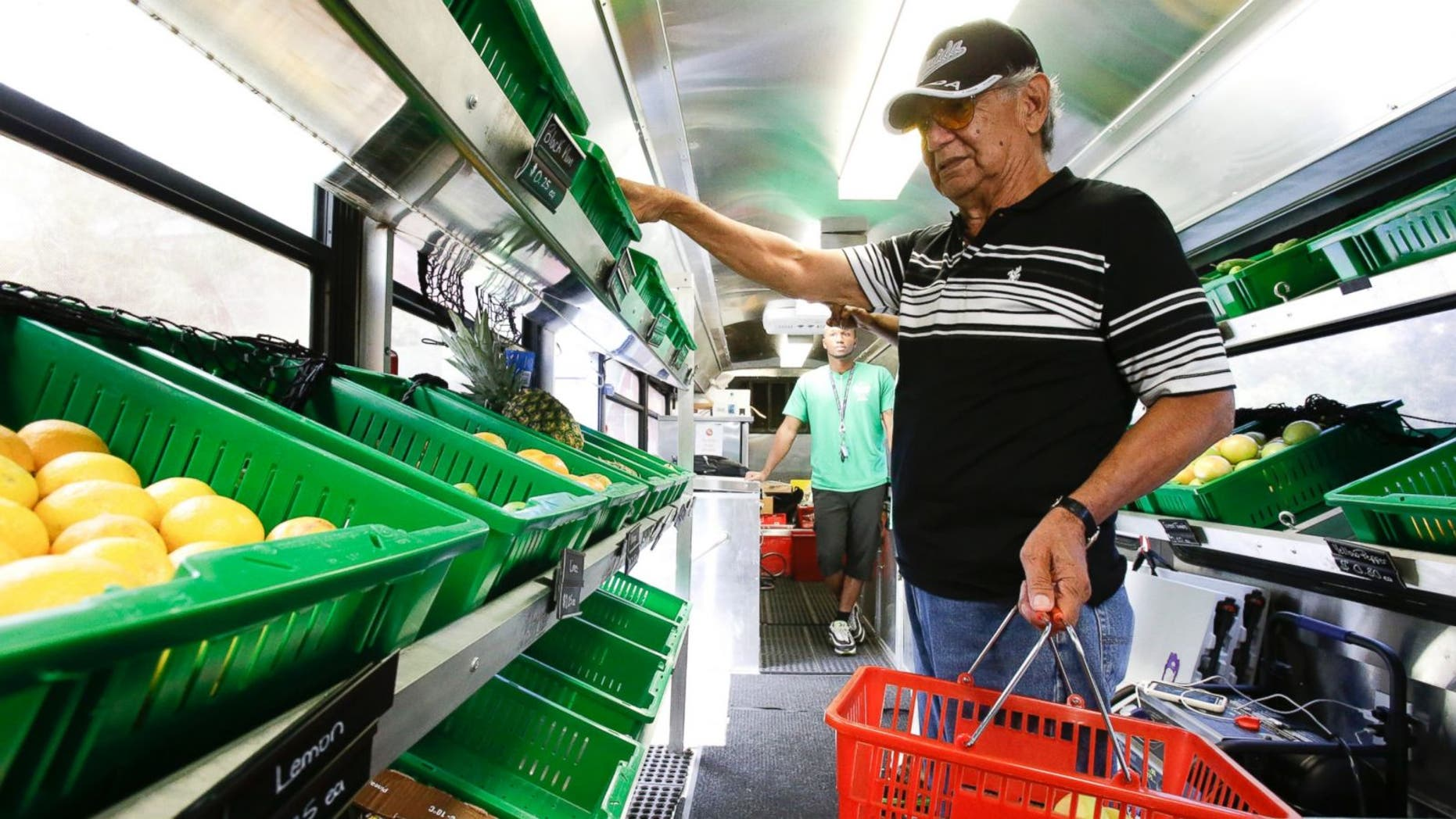 Pablo Salazar shops for fruits and vegetables in the Fresh Stop bus, a mobile market, at the Taft Community Center, in Orlando, Fla. The Fresh Stop brings fresh fruits and vegetables to communities with no supermarkets.