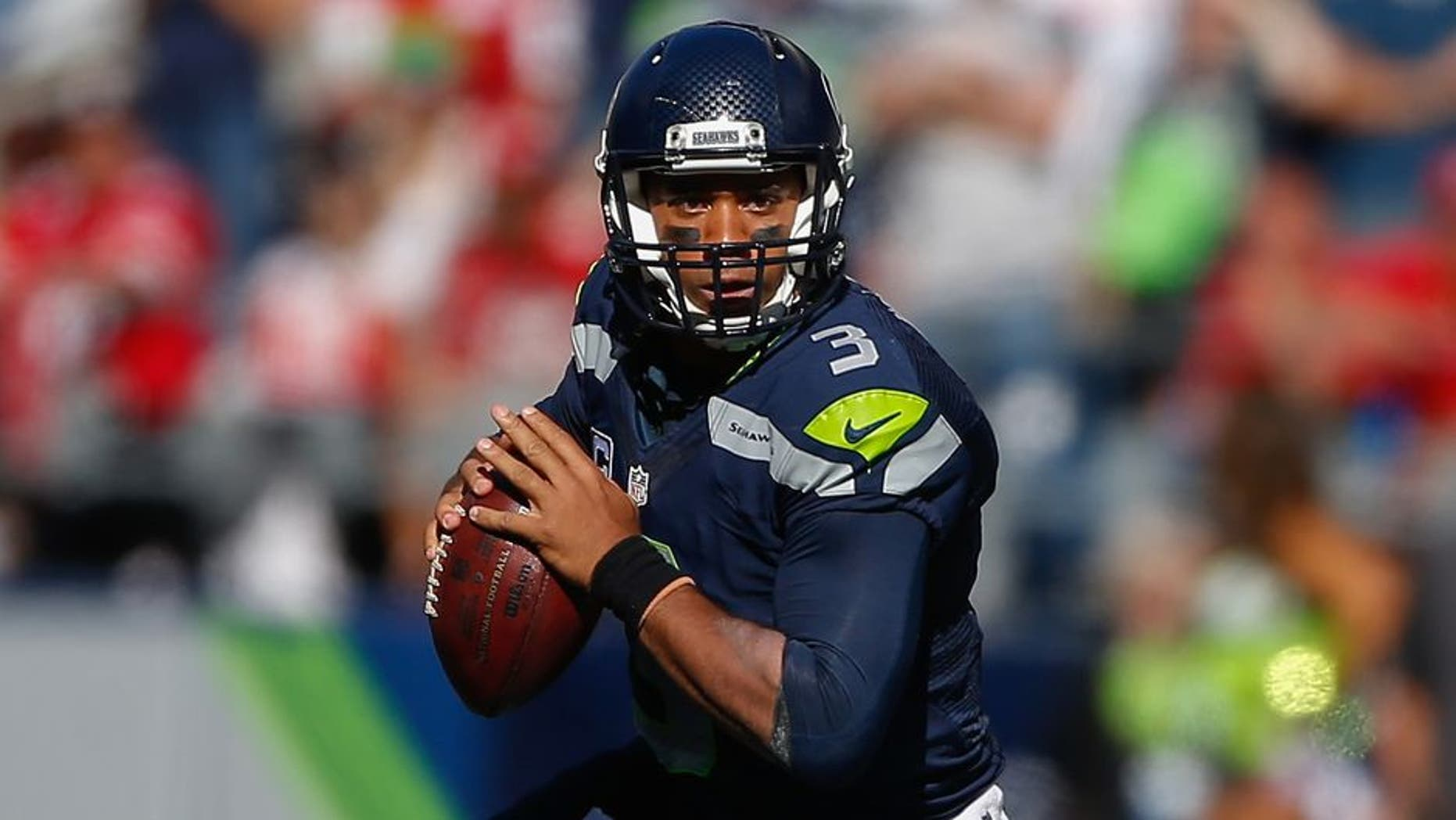 SEATTLE, WA - SEPTEMBER 25: Quarterback Russell Wilson #3 of the Seattle Seahawks rushes against the San Francisco 49ers at CenturyLink Field on September 25, 2016 in Seattle, Washington. The Seahawks defeated the 49ers 37-18. (Photo by Otto Greule Jr/Getty Images)
