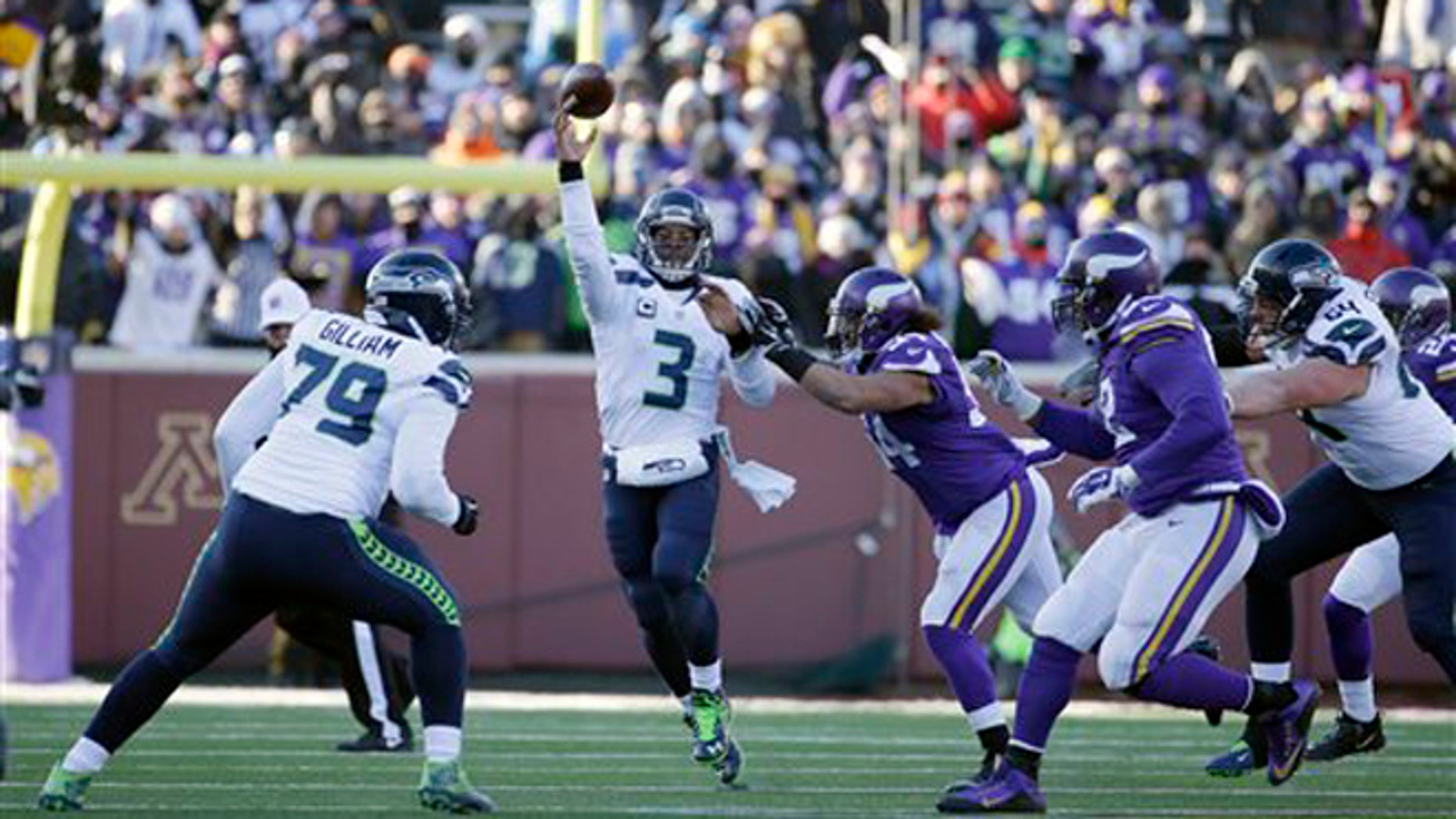 Seattle Seahawks quarterback Russell Wilson (3) throws a pass to Seattle Seahawks wide receiver Tyler Lockett during the second half of an NFL wild-card football game against the Minnesota Vikings, Sunday, Jan. 10, 2016, in Minneapolis. (AP Photo/Nam Y. Huh)