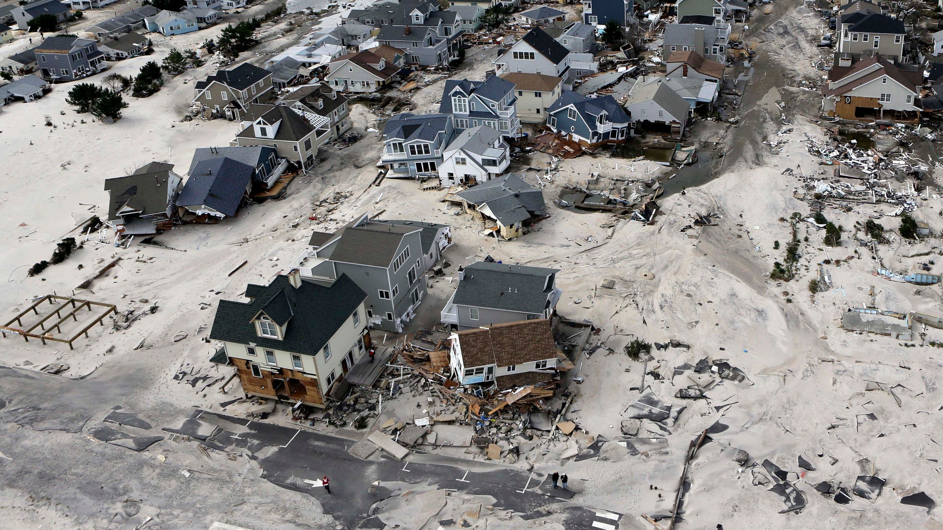 In this Oct. 31, 2012 file photo, a view from the air shows the destroyed homes left in the wake of Superstorm Sandy in Ortley Beach, N.J. (AP Photo/Mike Groll, File)
