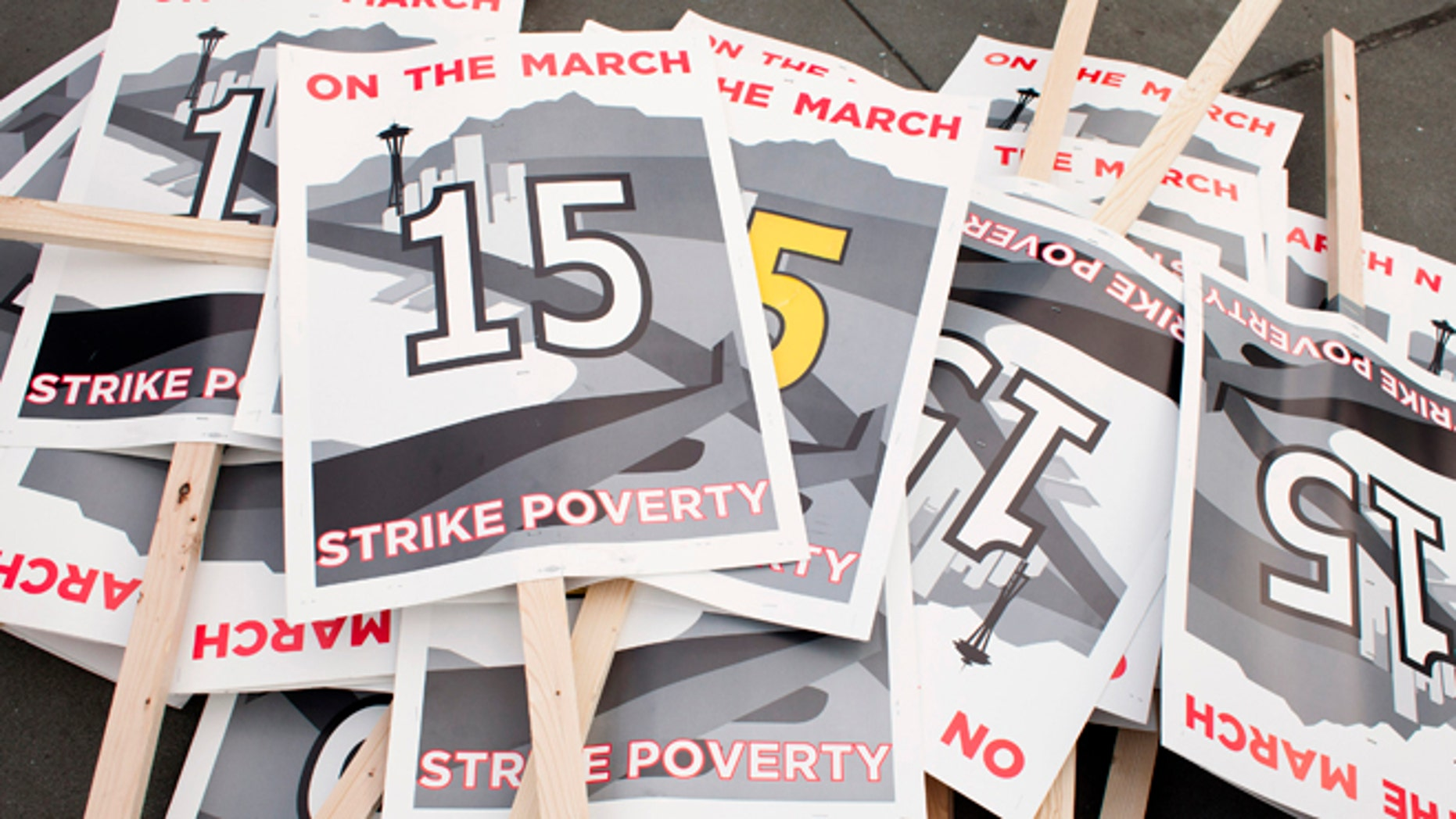 Dec. 5, 2013: Protest signs are pictured in SeaTac, Wash., before a march in support of raising the minimum wage to $15 an hour.