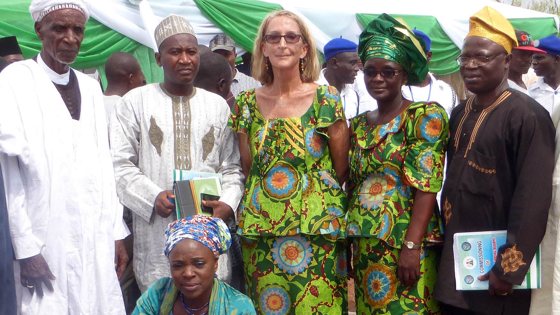 March 6, 2015: Seattle missionary Rev. Phyllis Sortor, center, stands with a delegation of area dignitaries in a town in Nigeria.