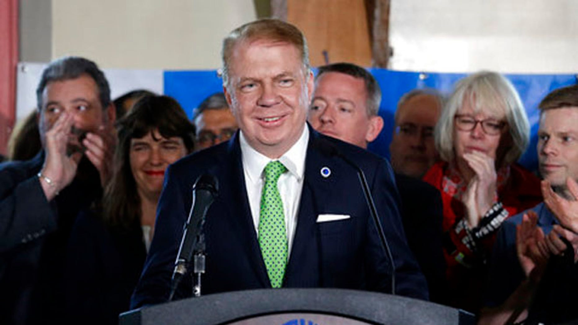 May 9, 2017: Seattle Mayor Ed Murray briefly smiles as supporters applauds his entrance before saying that he is dropping his re-election bid for a second term in Seattle.