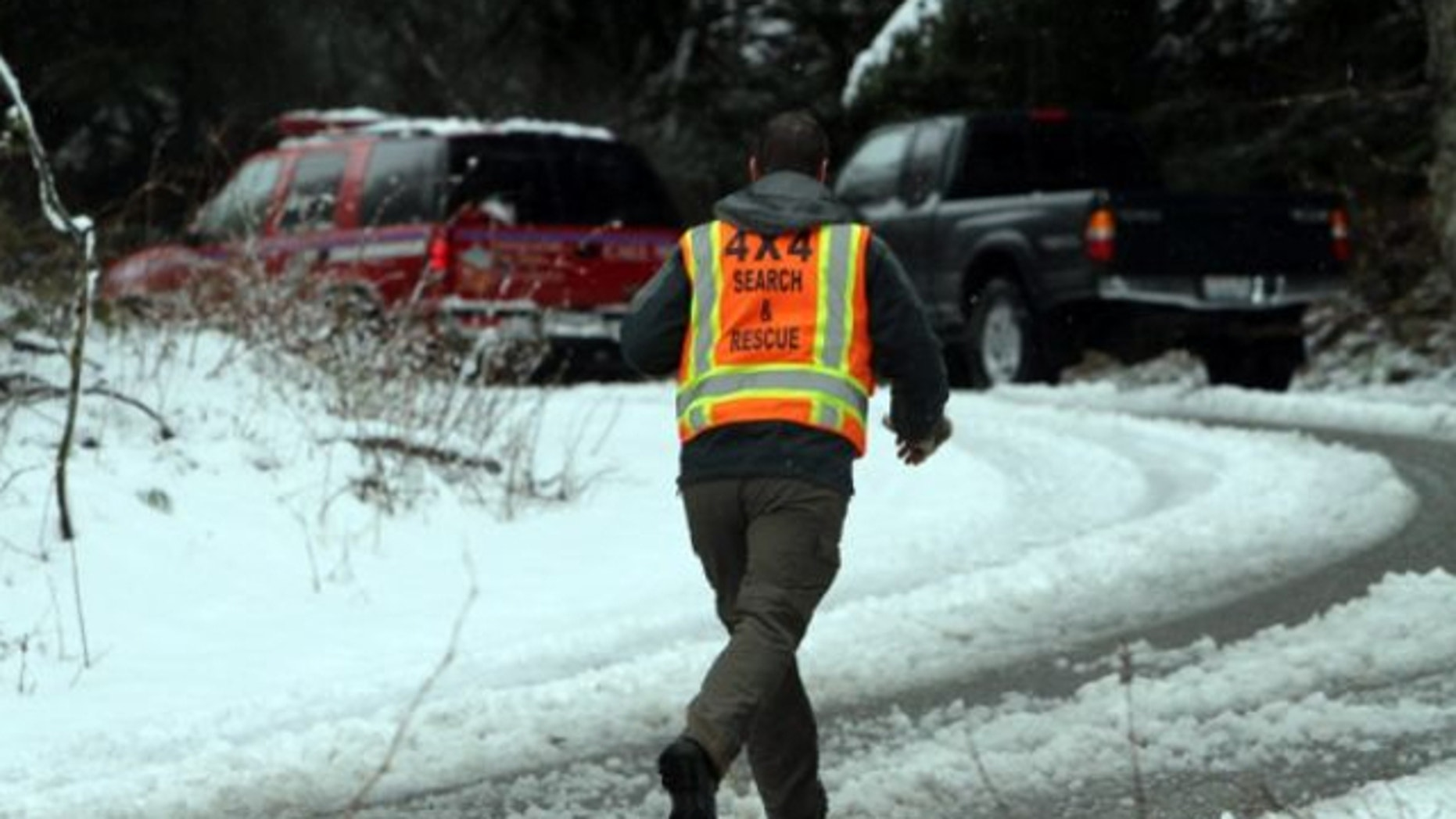 April 13, 2013: A man with King County Search and Rescue runs toward scene of avalanche at exit 47 along I-90 near Snoqualmie Pass.