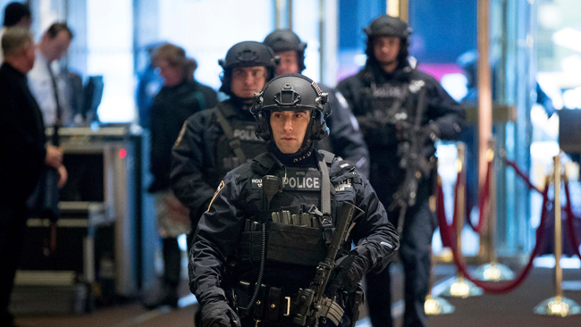 Police officers walk through the lobby of Trump Tower in New York City.