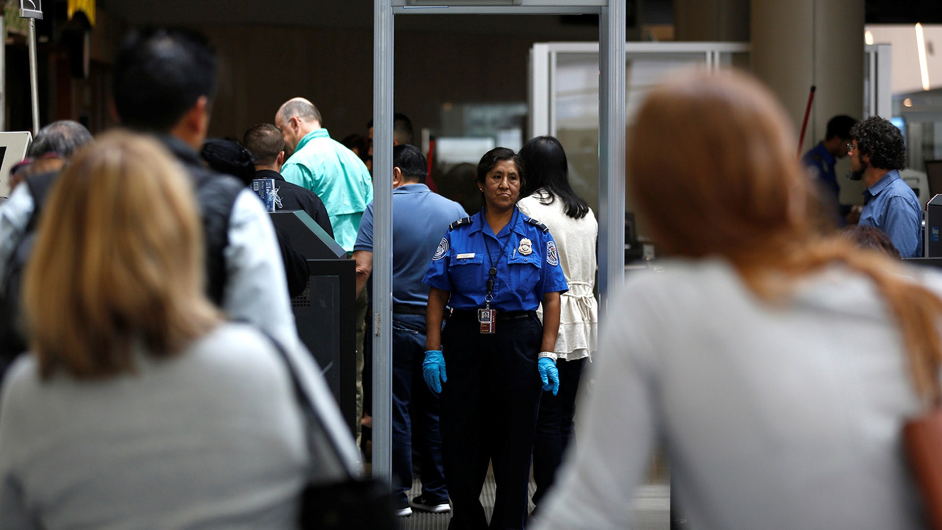 San Jose airport evacuates terminal to investigate security breach.