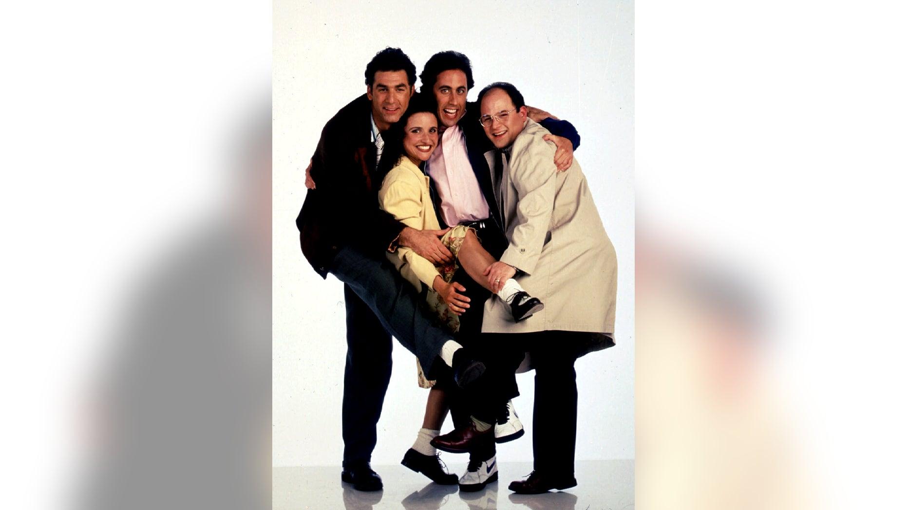 "Michael Richards, Julia Louis-Dreyfus, Jerry Seinfeld and Jason Alexander in ""Seinfeld."""