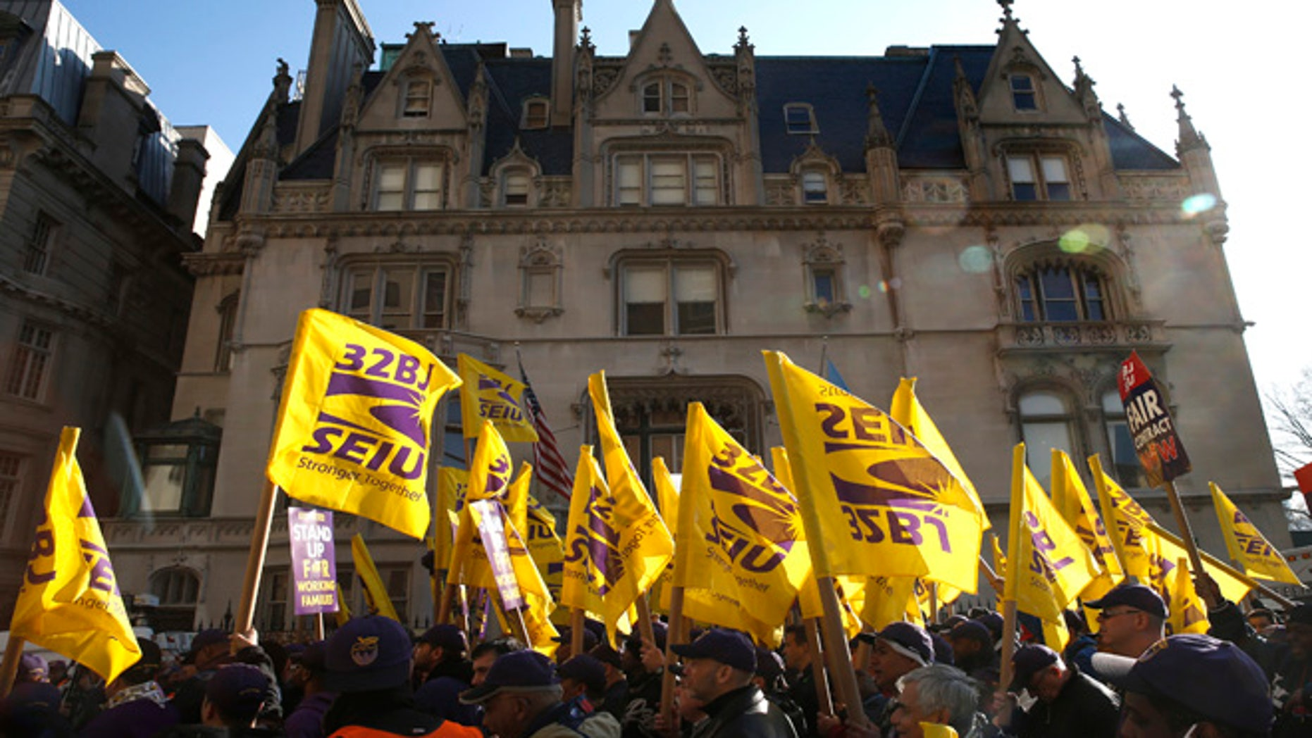 Members of the Service Employees International Union (SEIU) march during a protest in support of a new contract for apartment building workers in New York City, April 2, 2014.