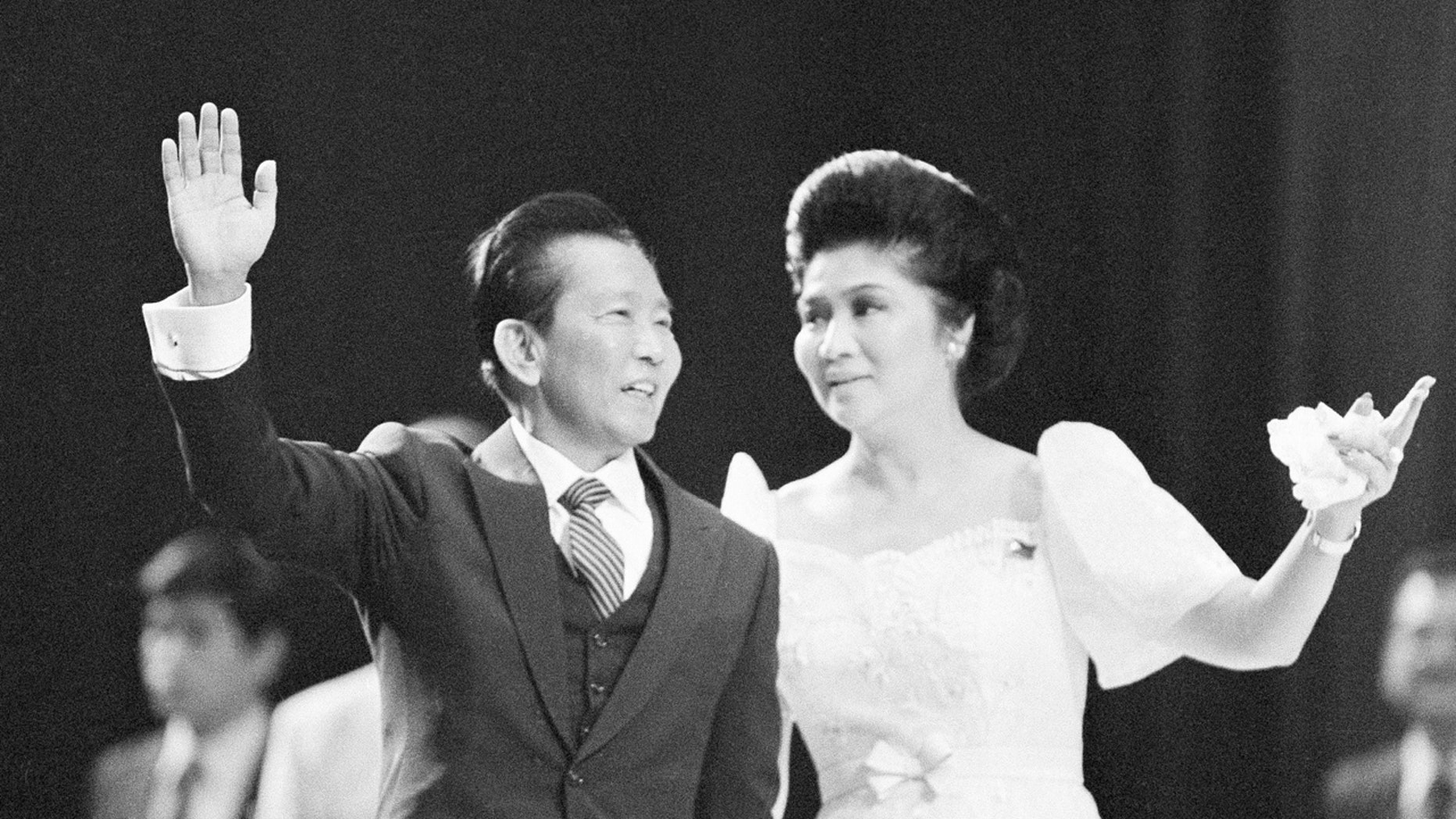 In this Sept. 26, 1982 file photo, Philippine President Ferdinand Marcos and First Lady Imelda Marcos appear at a rally in the Los Angeles Sports Arena.