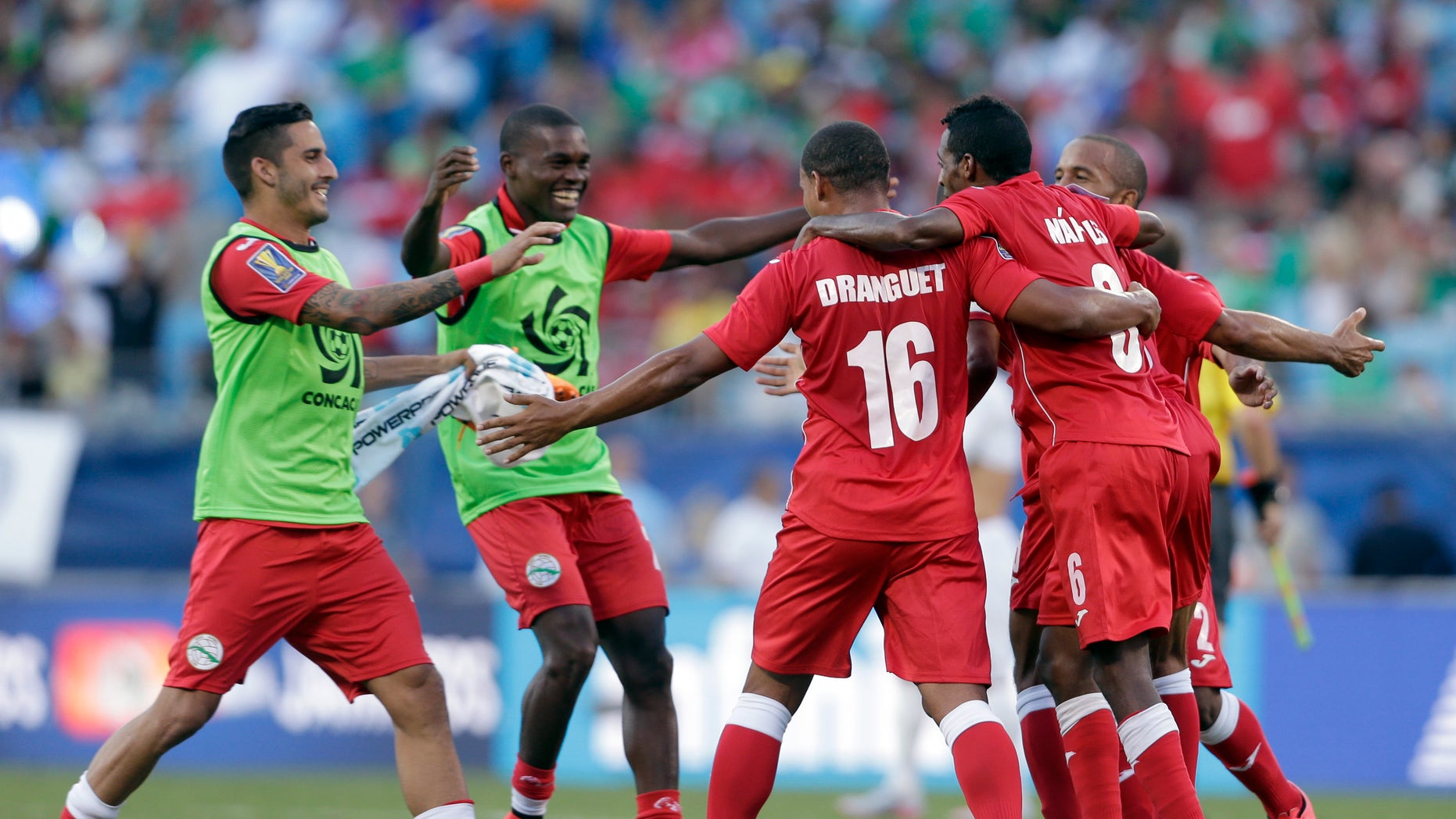 Cuba players celebrate after a CONCACAF Gold Cup soccer match against Guatemala in Charlotte, N.C., July 15, 2015.