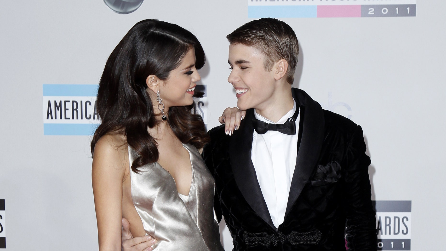 November 20, 2011. Justin Bieber and  Selena Gomez, arrive at the 2011 American Music Awards in Los Angeles.