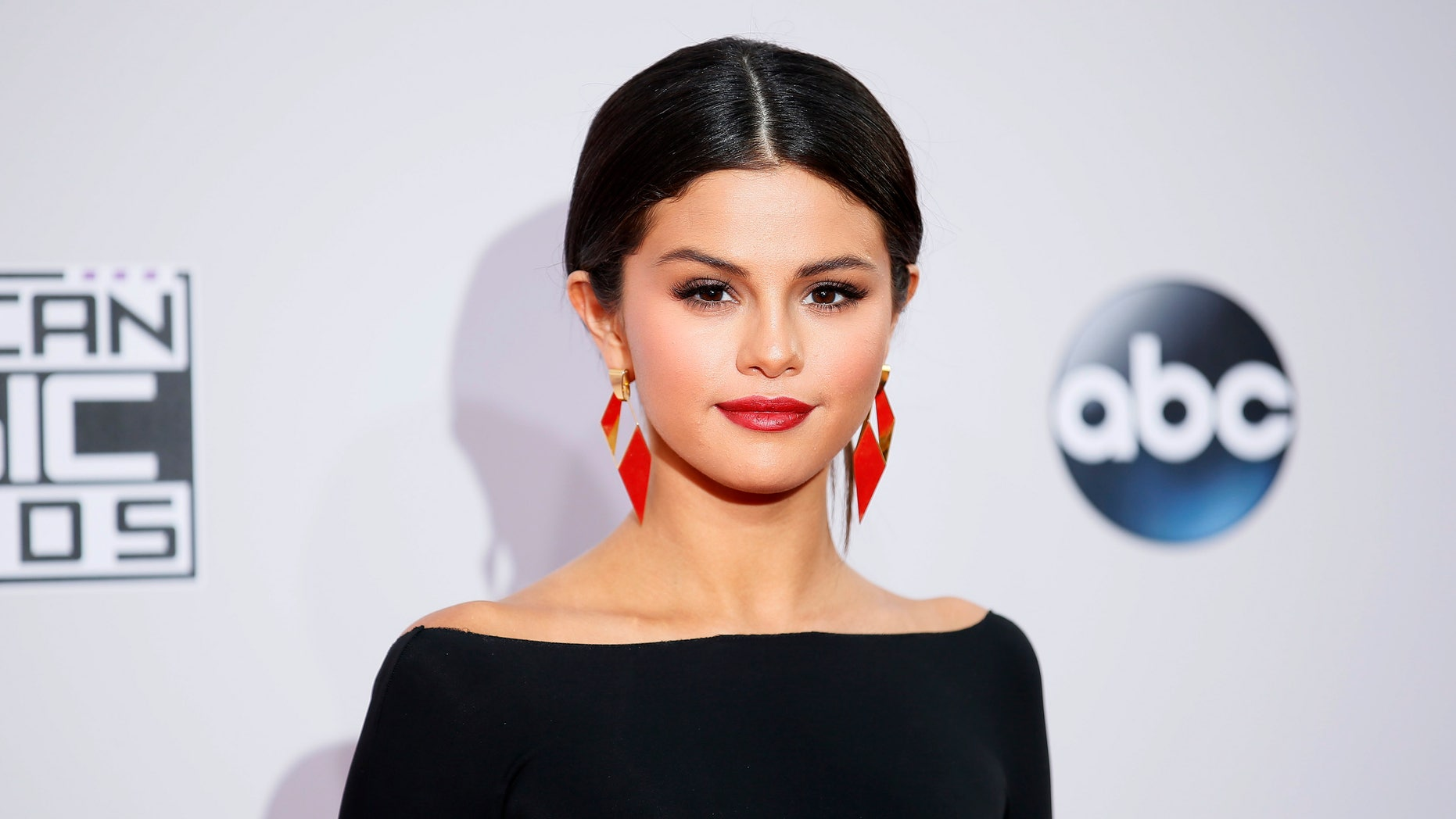 November 23, 2014. Singer Selena Gomez arrives at the 42nd American Music Awards in Los Angeles, California.