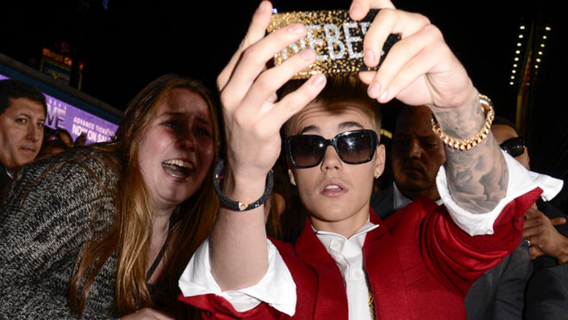 """Dec. 18, 2013: Singer Justin Bieber takes a """"selfie"""" with a fan at the premiere of the feature film """"Justin Bieber's Believe"""" at Regal Cinemas L.A. Live  in Los Angeles."""
