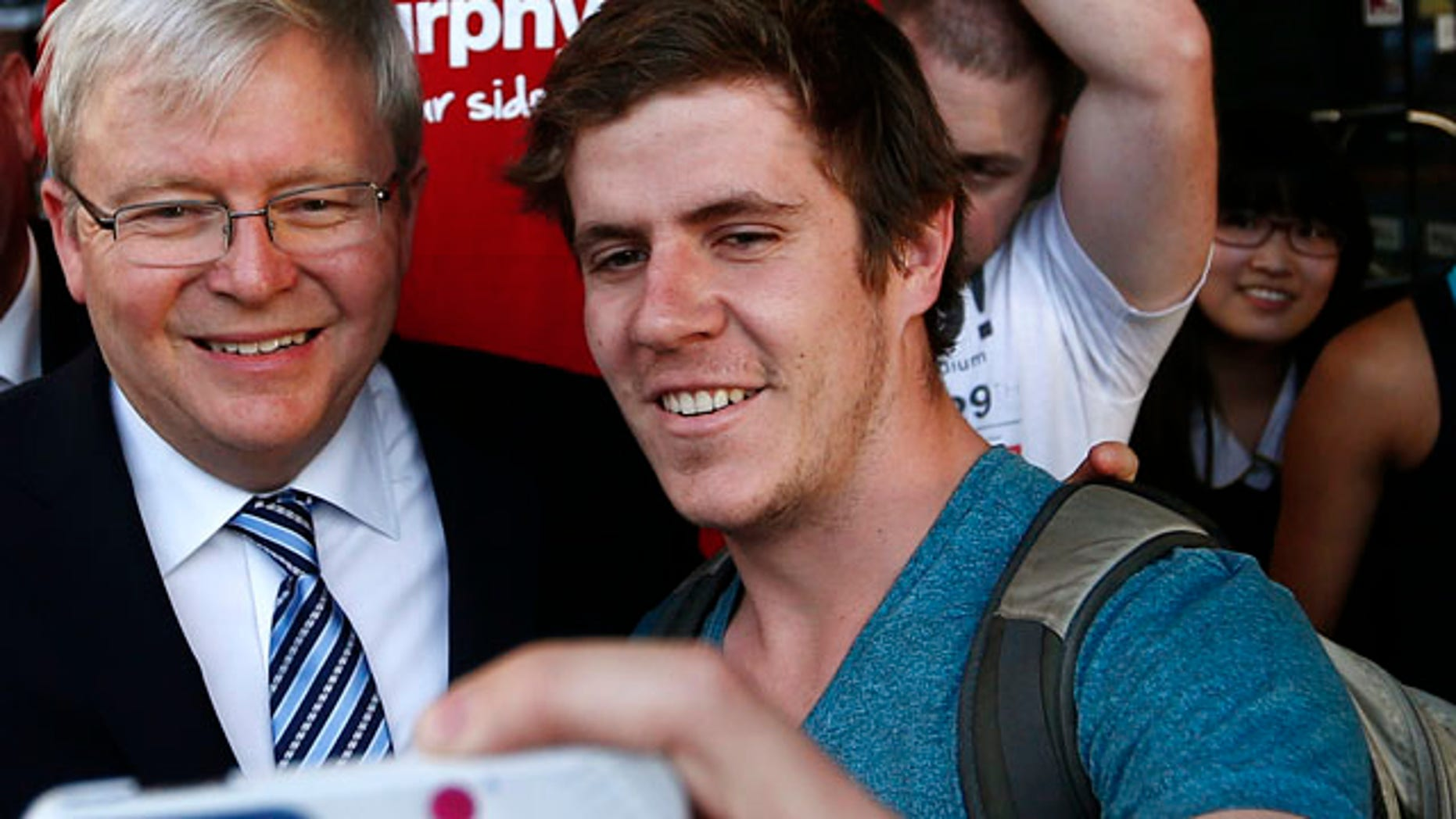 Sept. 5, 2013: Australian Prime Minister Kevin Rudd (2nd L) poses as a man takes a 'selfie' on his mobile phone.