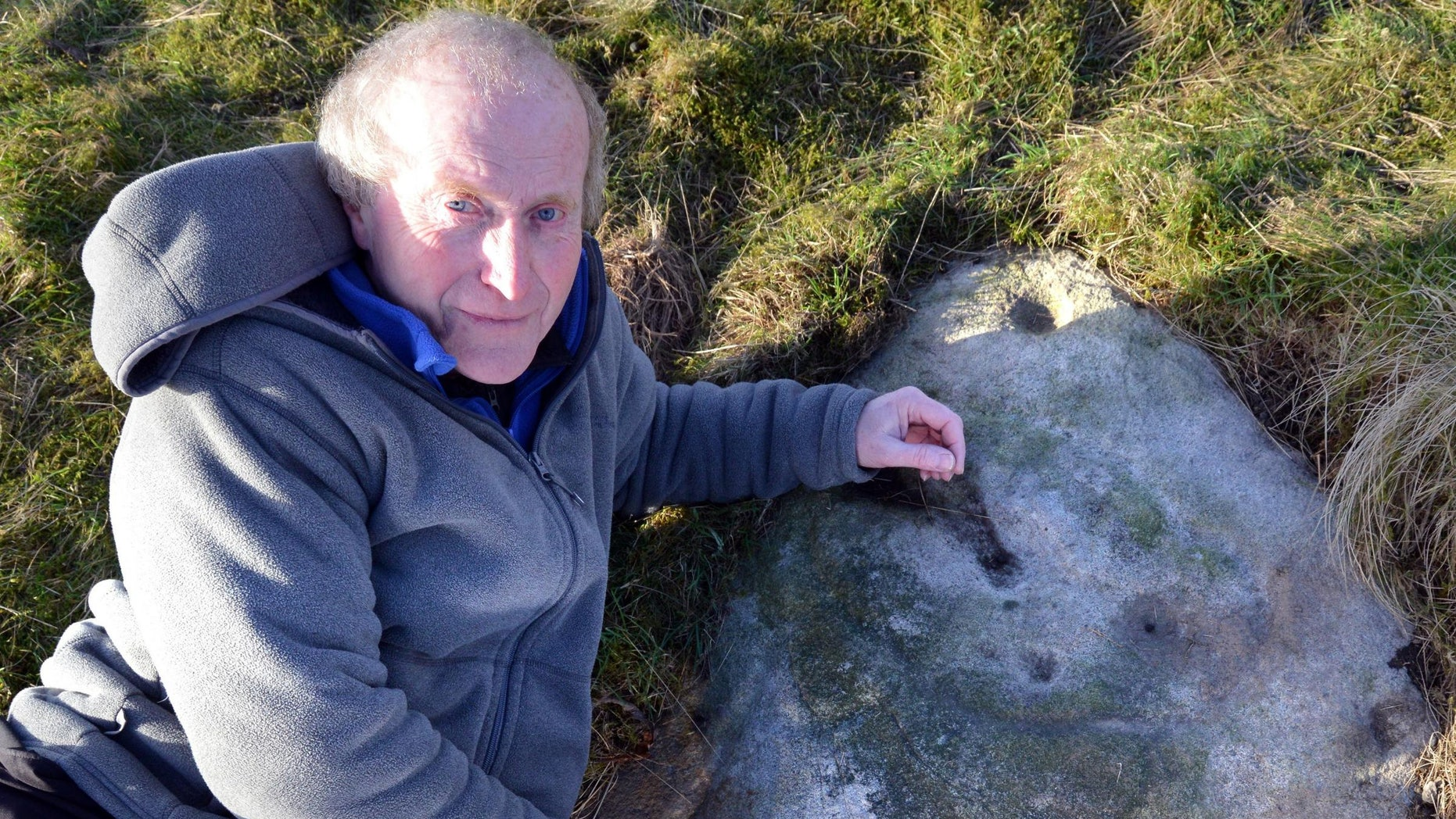 Gordon Holmes on Baildon Moor with what he believes is a Stone Age selfie of a person under the symbol for Cassiopeia.