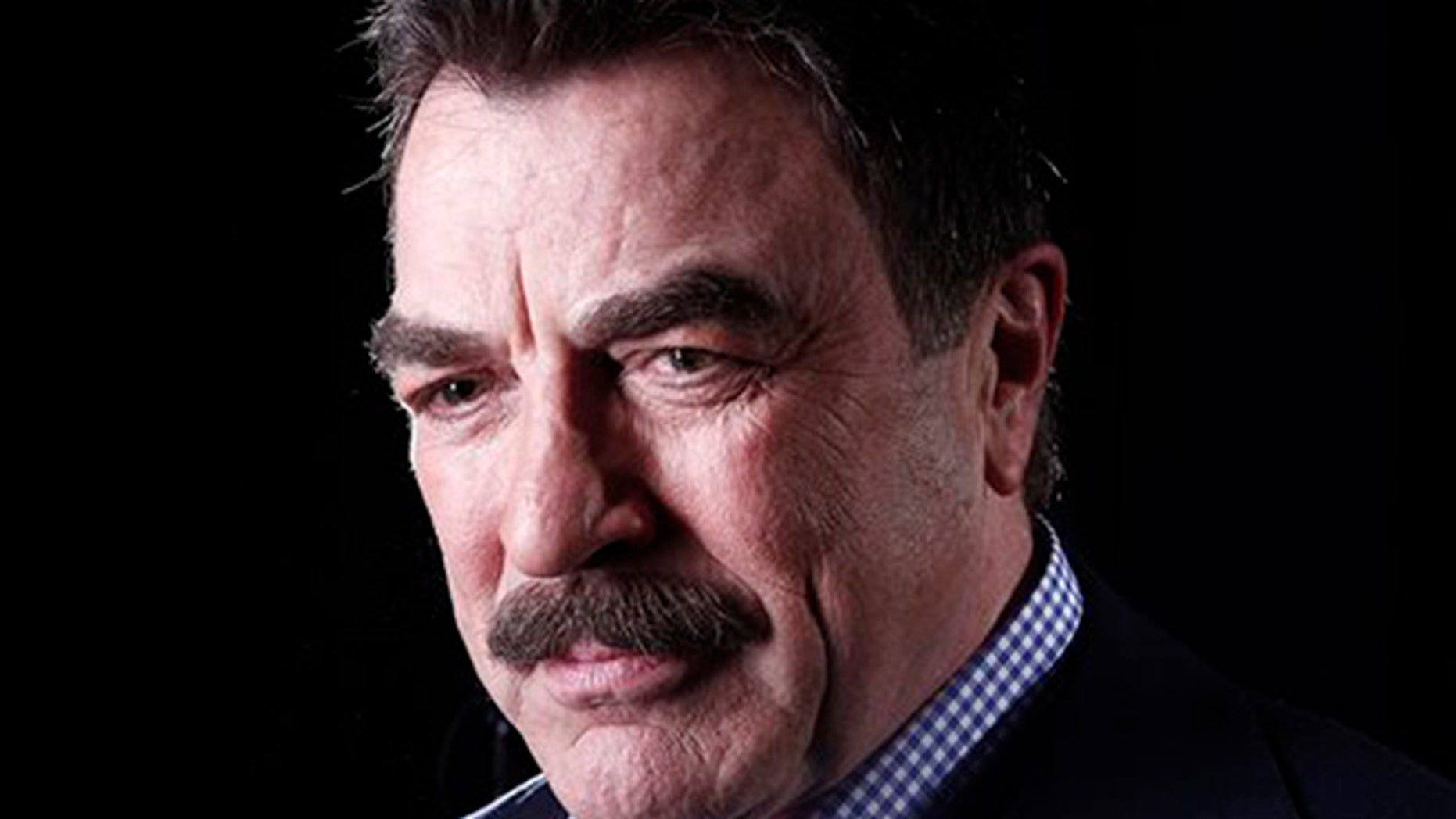 This file photo shows Actor Tom Selleck posing for a portrait in New York.  (AP Photo/Carlo Allegri, File)