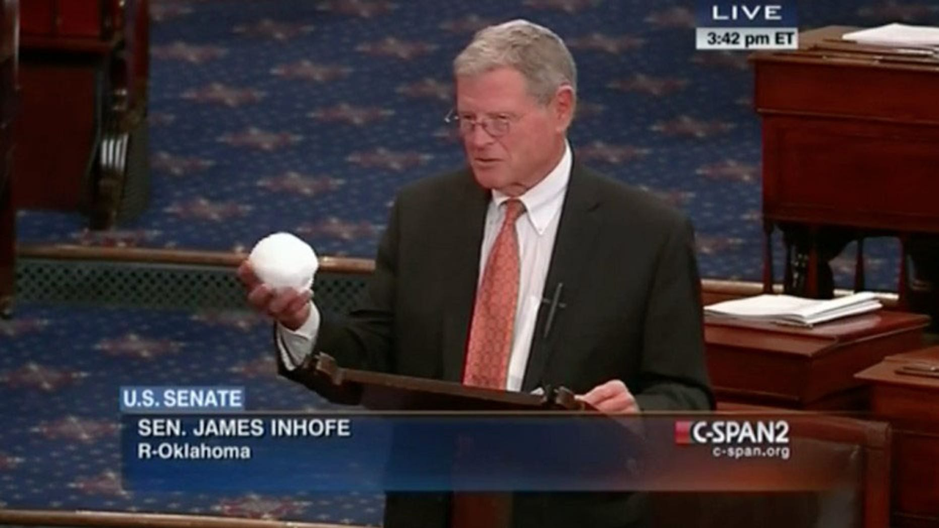 Sen. James Inhofe, R-Okla., holds up a snowball during a speech on the Senate floor on February 26, 2015. (Screenshot from C-SPAN)