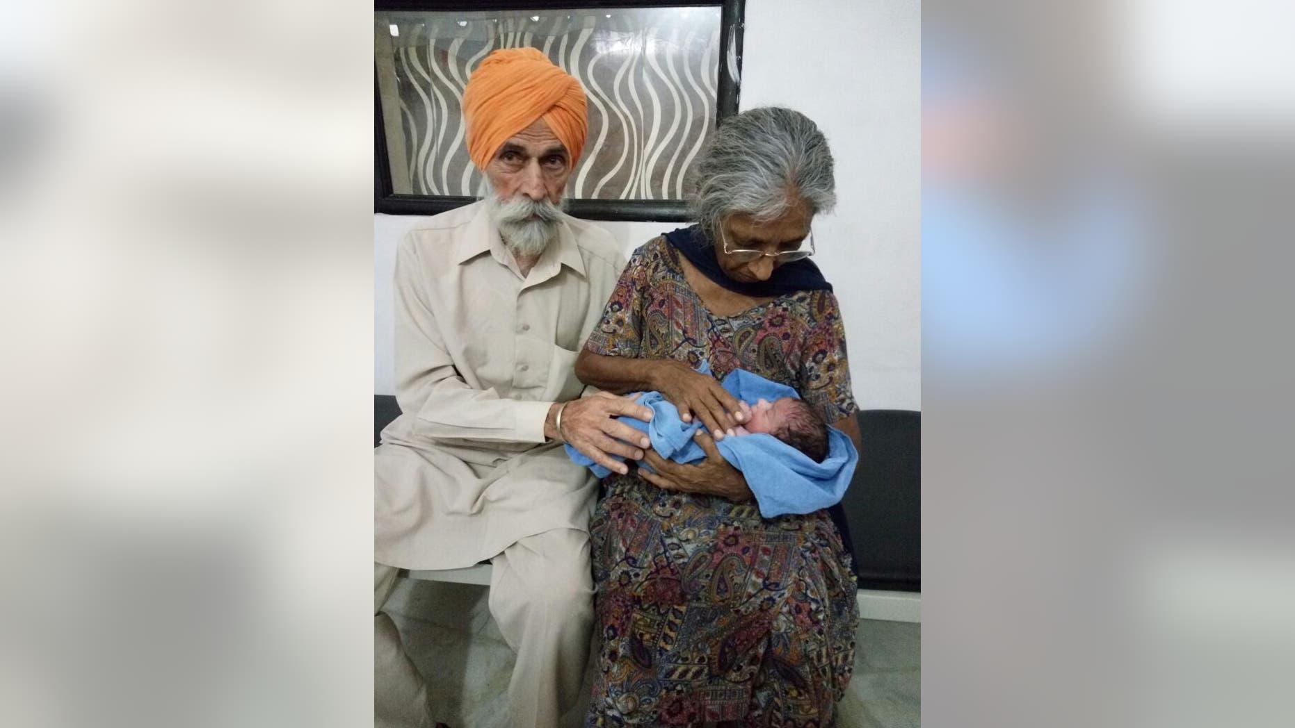 Mohinder Singh Gill and Daljinder Kaur with their newborn son.