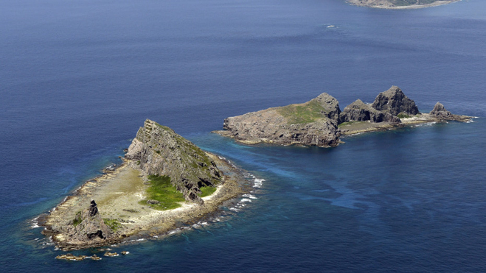 In this Sept. 2012 photo, the tiny islands in the East China Sea, called Senkaku in Japanese and Diaoyu in Chinese, are seen.