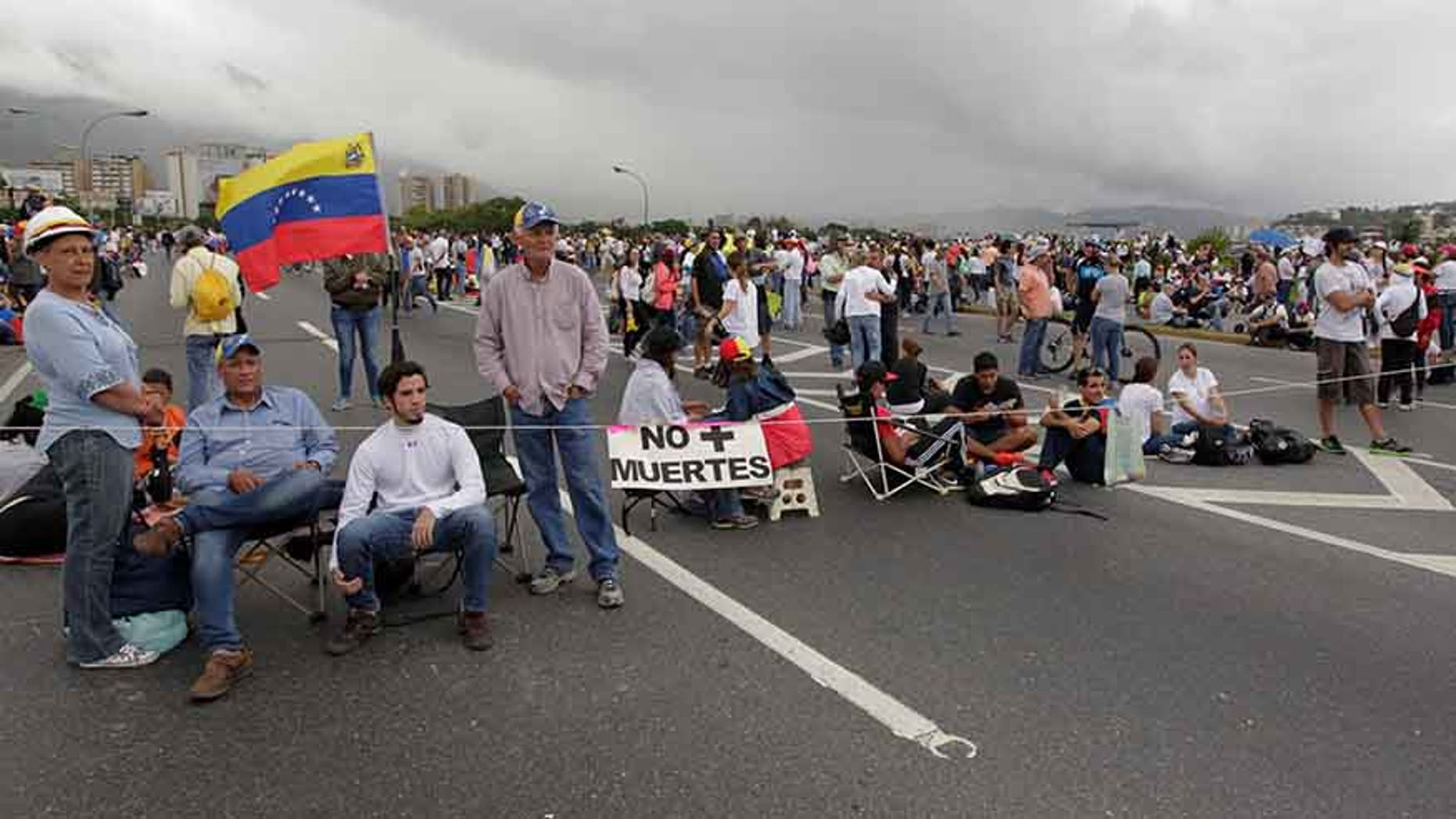 """A group of protesters participate in a """"Big National Sit-in,"""" called by the opposition in Caracas, Venezuela, May 15, 2017."""